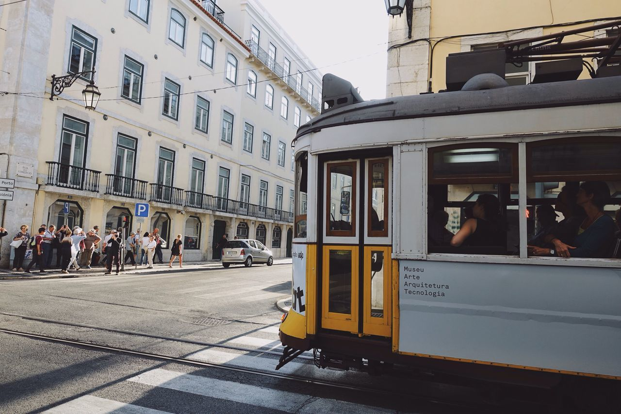 Embrace Urban Life 🌇🚋🌆🚋🏙🚋🌃//. Public Transportation City City Life Cityscapes Streetphotography Street People Walking Train Enjoy The New Normal Urban Life Lifestyles Europe Travel Lisbon Modern Old-fashioned Traffic Sunlight Tourism My Year My View Building Adapted To The City