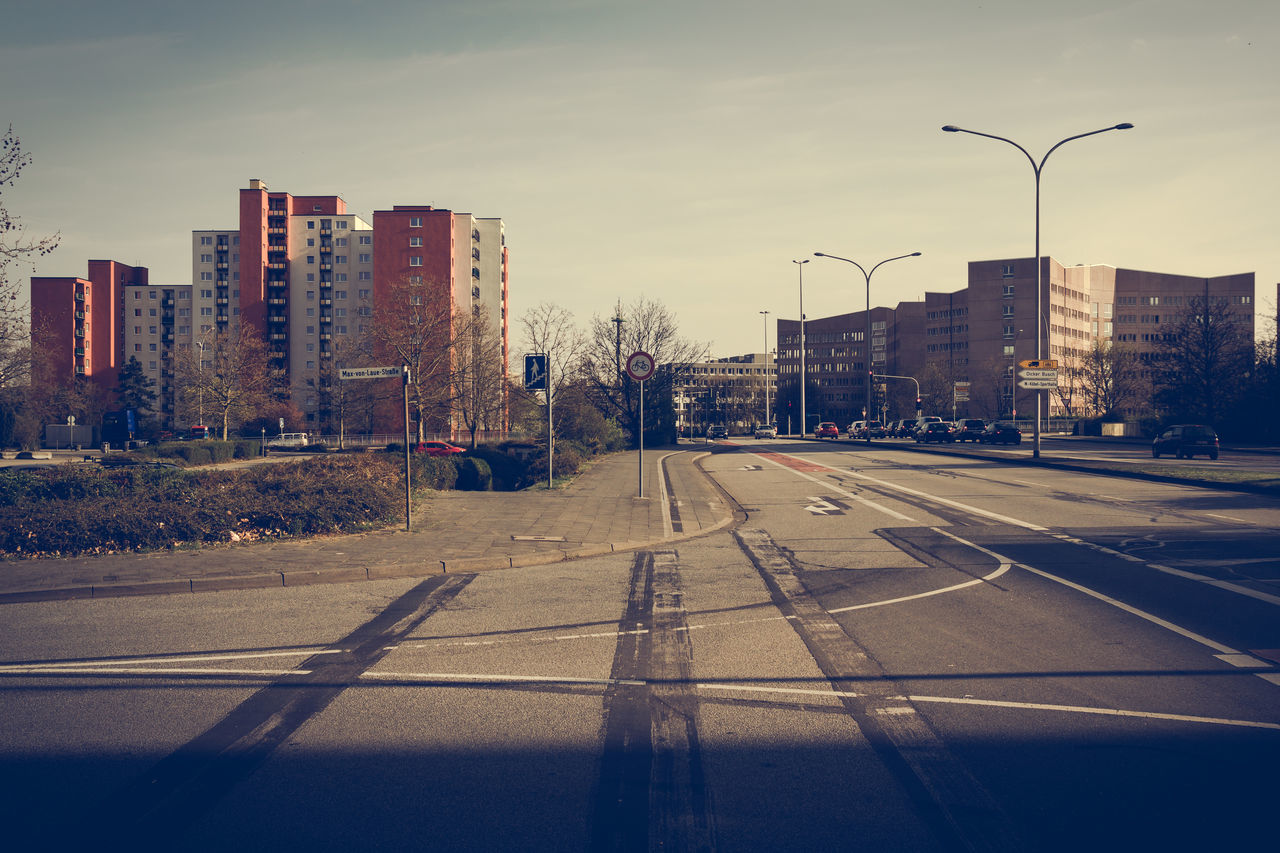 Arterial Road Architecture Arterial Road Building Building Exterior Built Structure City City Life City Street Cityscape Day Dicker Busch Diminishing Perspective Empty Modern No People Office Building Outdoors Road Road Marking Sky Street Light Tall - High The Way Forward Travel Destinations Vanishing Point