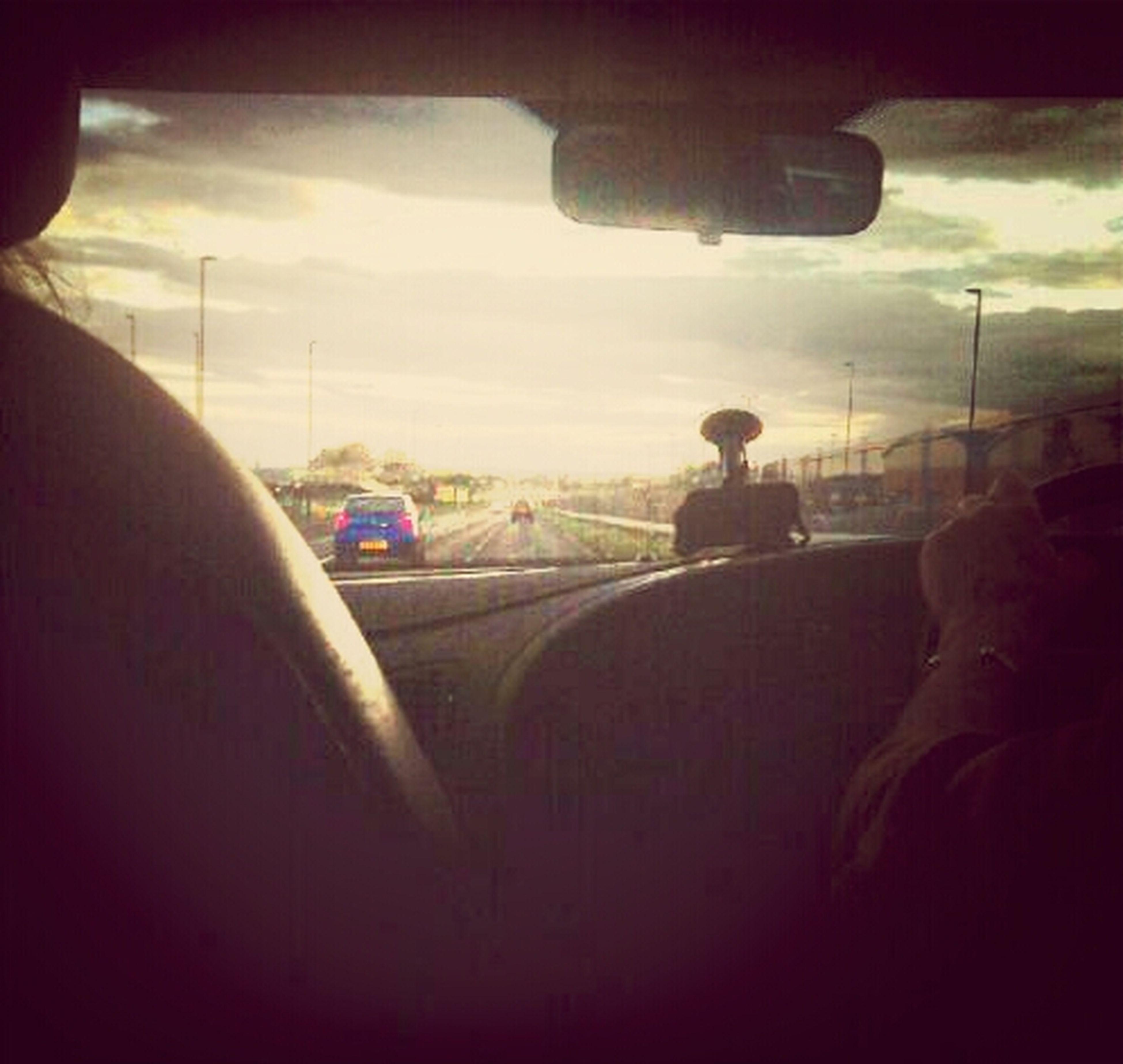 transportation, mode of transport, land vehicle, vehicle interior, car, sky, travel, cloud - sky, road, journey, window, public transportation, street, cloud, windshield, transparent, indoors, vehicle seat, on the move