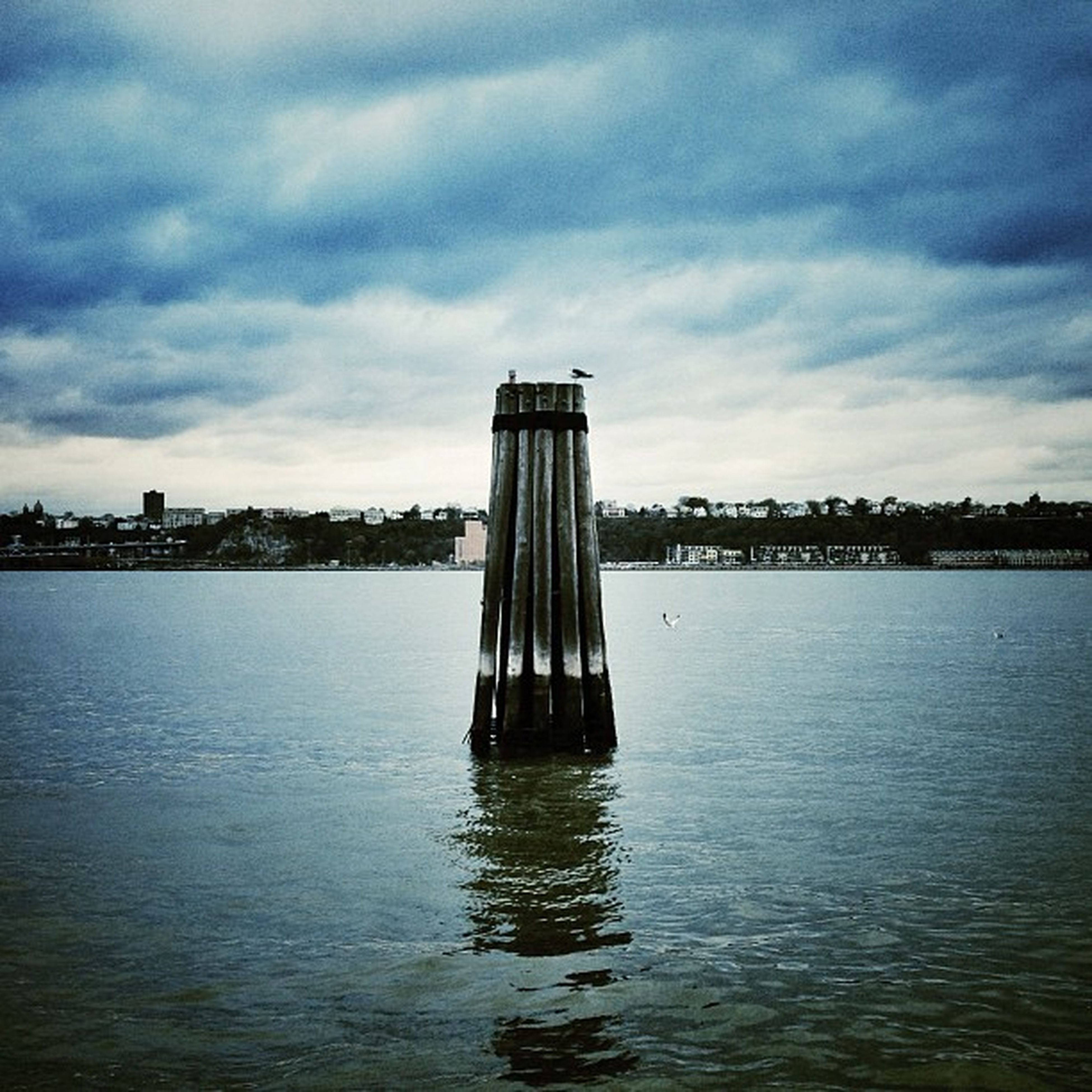 water, sky, architecture, built structure, waterfront, cloud - sky, building exterior, sea, cloudy, cloud, rippled, river, nature, tranquility, tranquil scene, reflection, no people, outdoors, day, lake