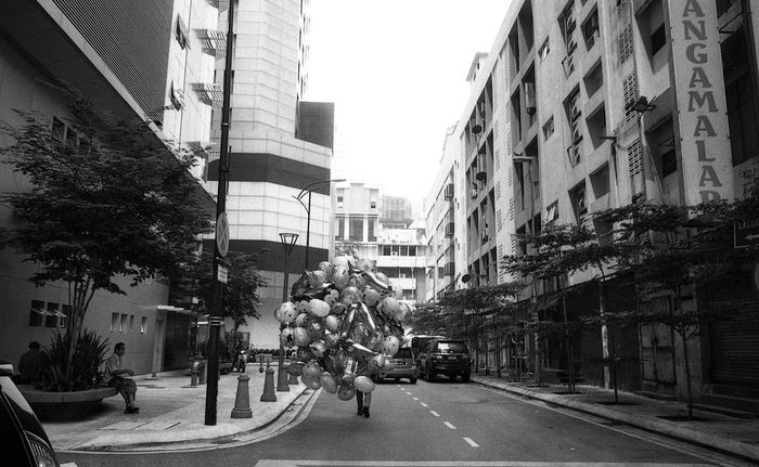The guy who sells Balloon Portrait Film Photography EyeEm Malaysia EyeEmMalaysia Streetphotography Filmisnotdead Film Believeinfilm B&w Street Photography Leicam