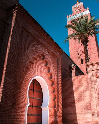 Koutoubia Marrakech Morocco #trip Travel Traveling Mosque Building Exterior Artisanat Old Sky Door Palm Tree EyeEm Selects Arch Red Architecture Low Angle View Night No People Outdoors