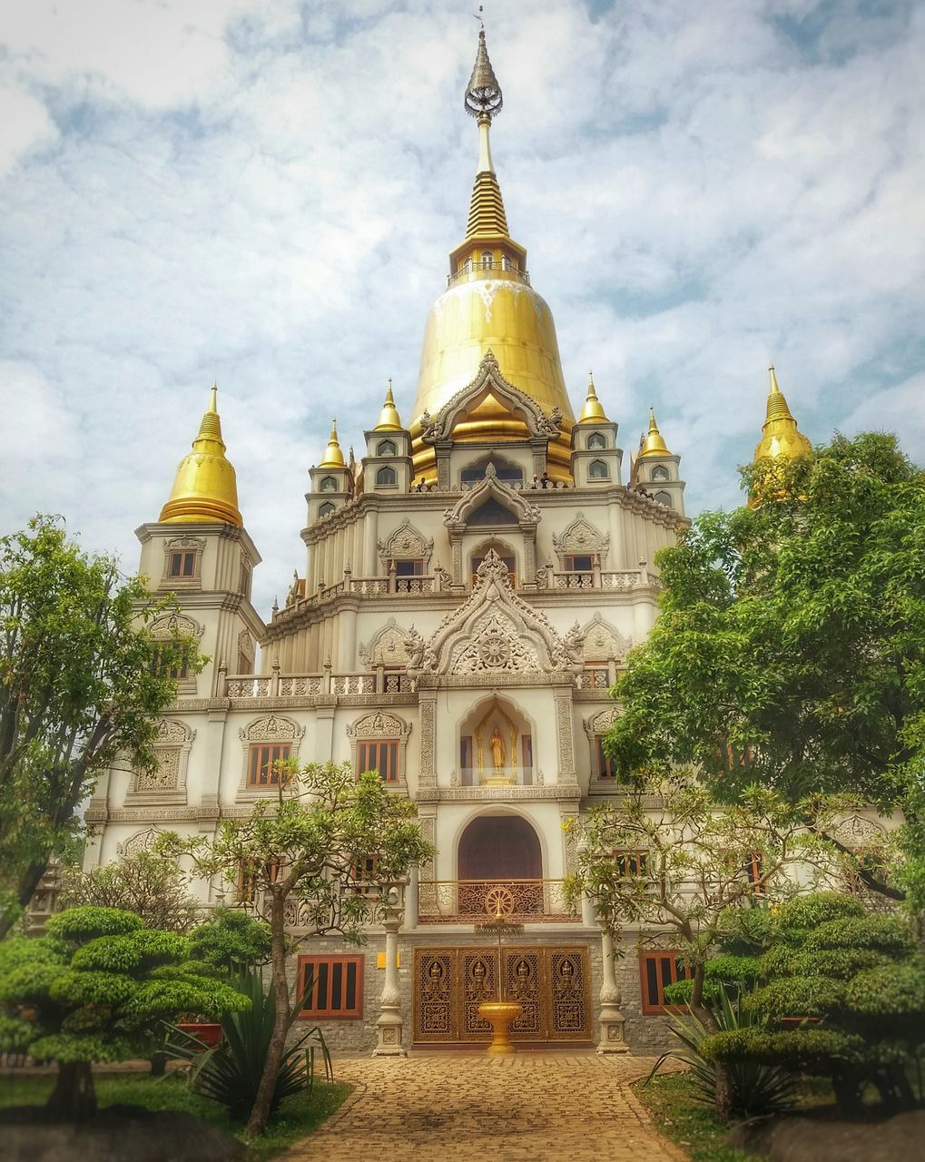 architecture, religion, place of worship, spirituality, built structure, building exterior, sky, tree, cloud - sky, gold colored, day, low angle view, dome, history, travel destinations, no people, outdoors