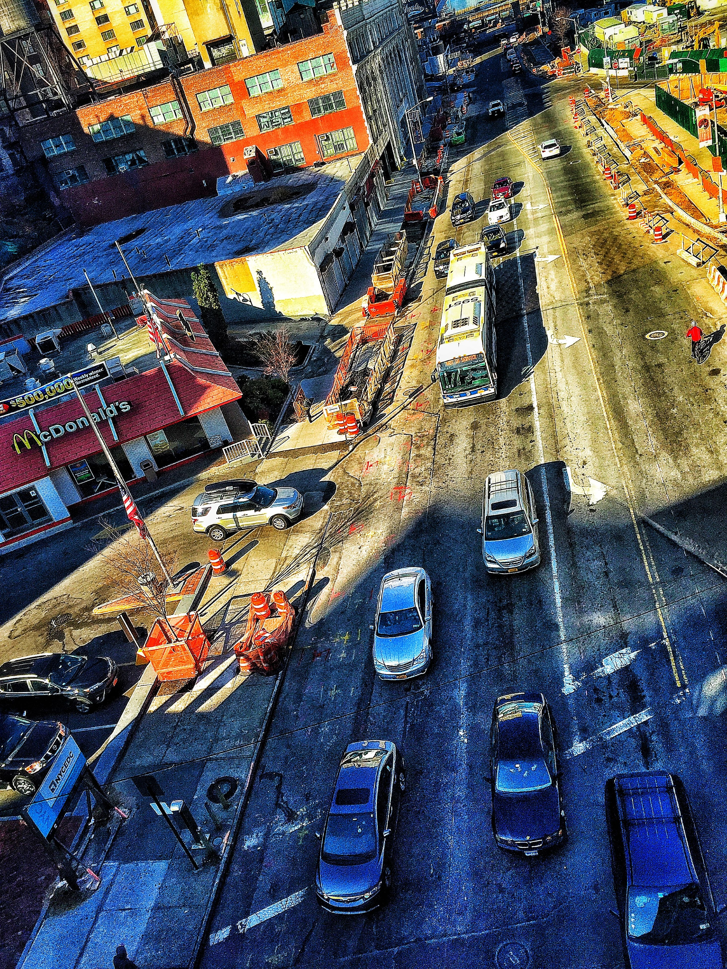 transportation, high angle view, street, land vehicle, road, mode of transport, car, built structure, architecture, city, wet, season, railroad track, outdoors, day, building exterior, the way forward, road marking, travel, no people