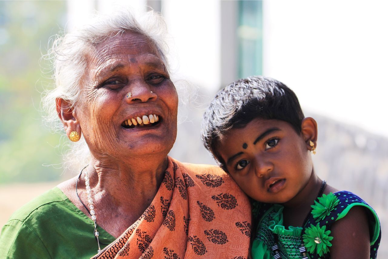 real people, two people, looking at camera, togetherness, senior women, focus on foreground, childhood, portrait, front view, senior adult, lifestyles, headshot, smiling, outdoors, leisure activity, day, happiness, boys, bonding, close-up