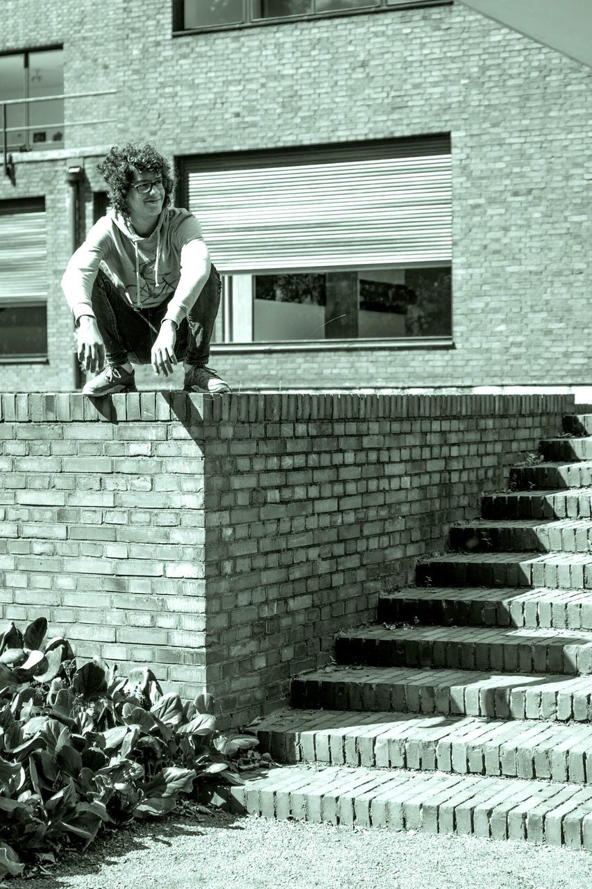full length, building exterior, built structure, one person, architecture, brick wall, real people, outdoors, steps and staircases, day, steps, mid-air, jumping, motion, lifestyles, happiness, young adult, animal themes, young women, people