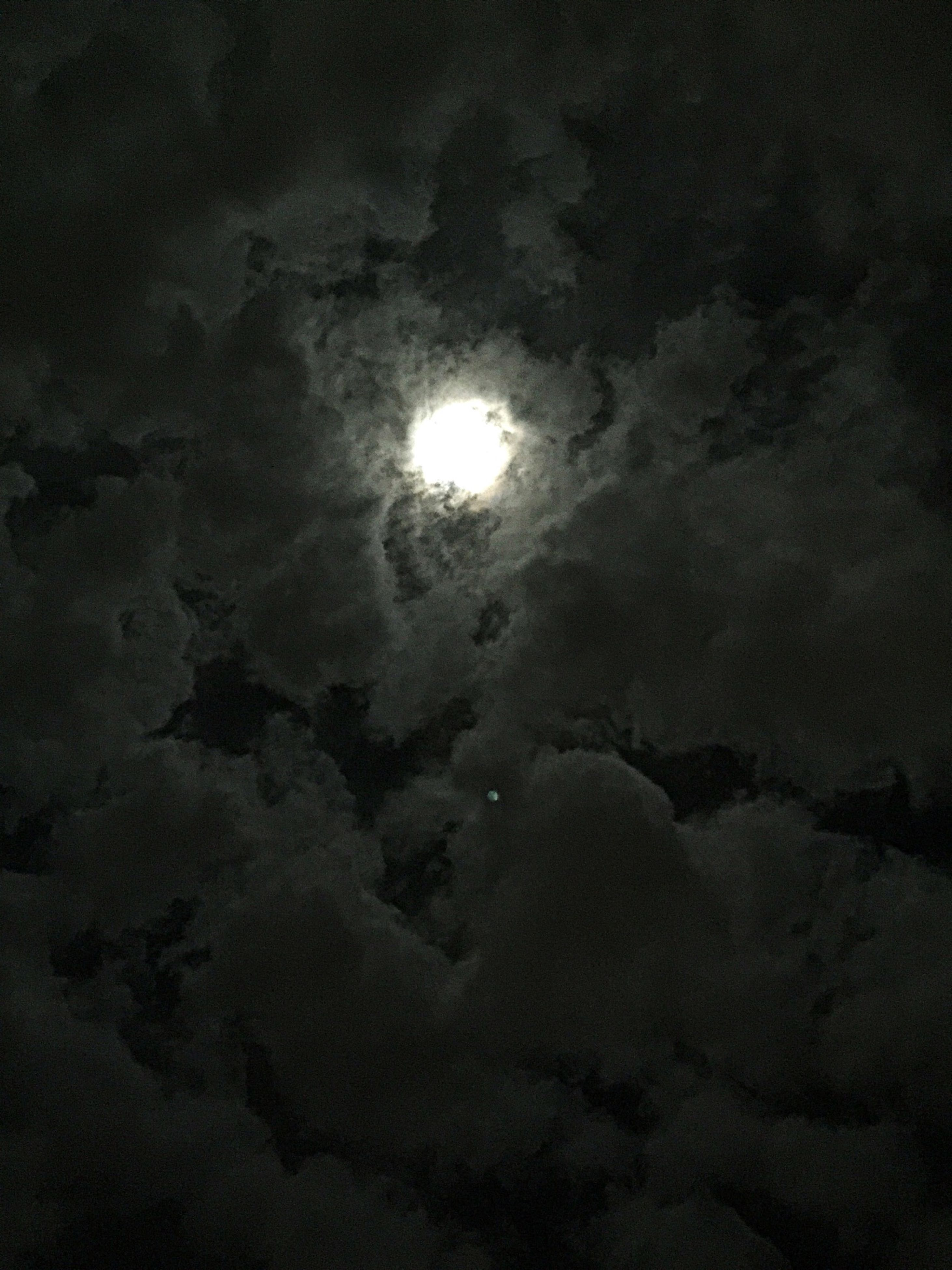 sky, night, beauty in nature, tranquility, scenics, low angle view, moon, nature, cloud - sky, tranquil scene, weather, astronomy, sky only, cloudy, idyllic, dark, majestic, backgrounds, no people, overcast