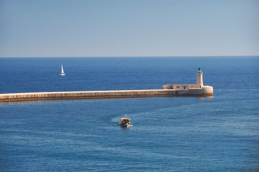 Entrance to the Grand Harbour, Valletta, Malta Sea Horizon Over Water Blue Sky Ocean Mediterranean  Lighthouse Pier Malta Valletta Grand Harbour Breakwater Waves Nature Beauty In Nature Scenics Outdoors Blue Tranquility Clear Sky No People Horizon Ship Yacht Boat Nautical Vessel