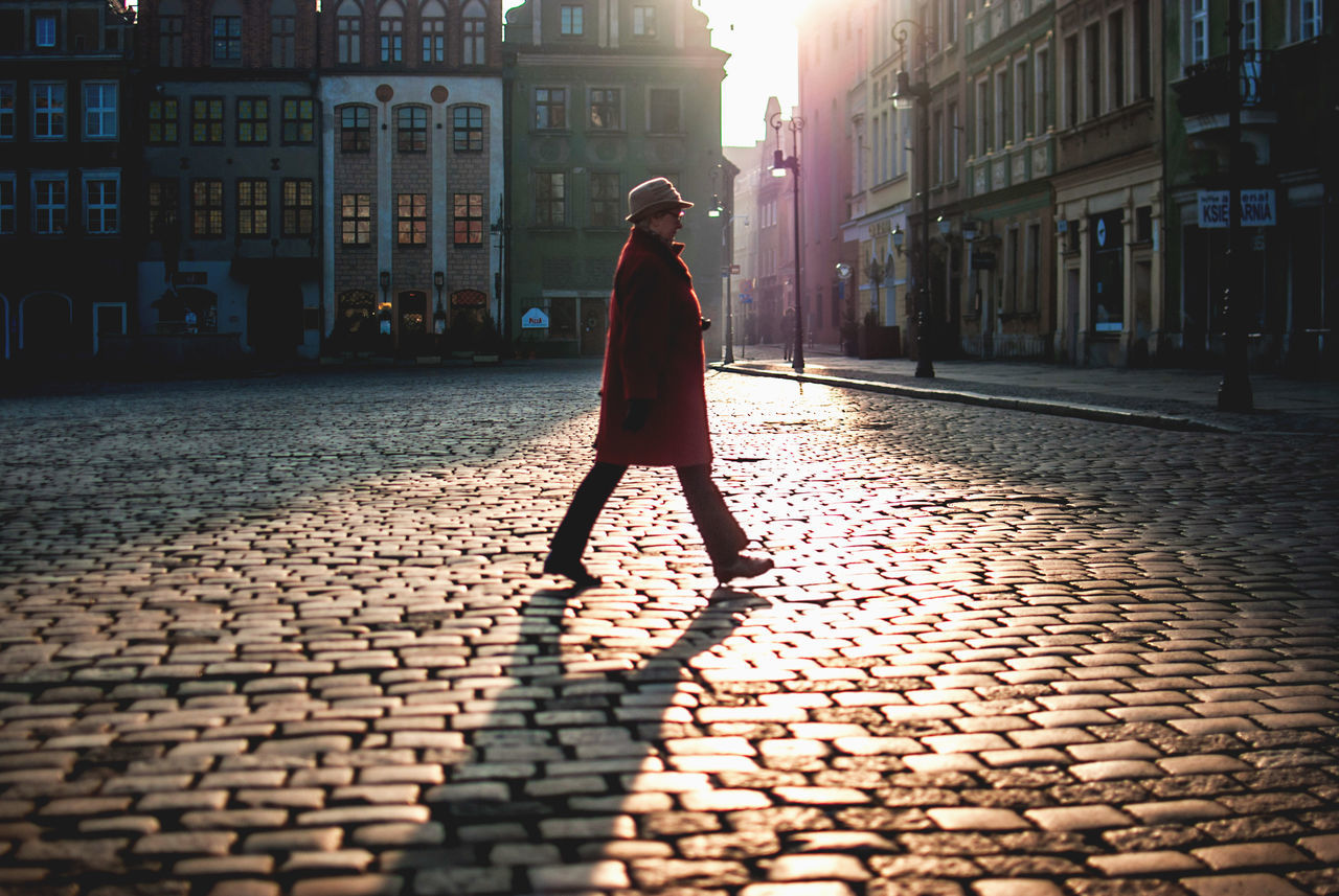 Adult Adults Only Back Lit Building Exterior Built Structure City City Cobblestone Discover Your City Europe Full Length Light And Shadow Nikon One Person One Woman Only Only Women Outdoors People Rear View Street Streetphotography The Week Of Eyeem Winter Women Young Adult