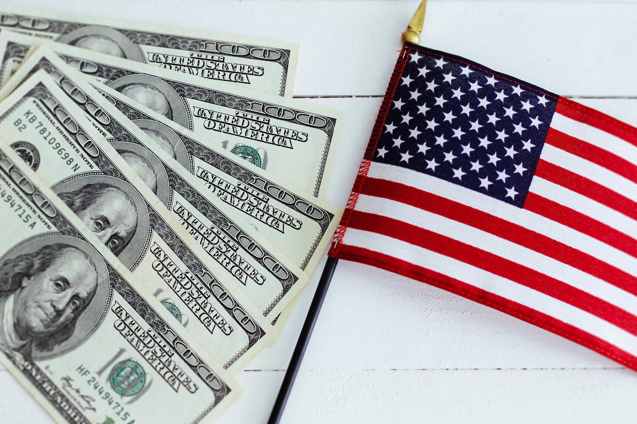 One hundred dollars notes and american flag America American Flag Crisis Currency Dollar Finance Government Independence Money Monochrome Note Paper Currency United States