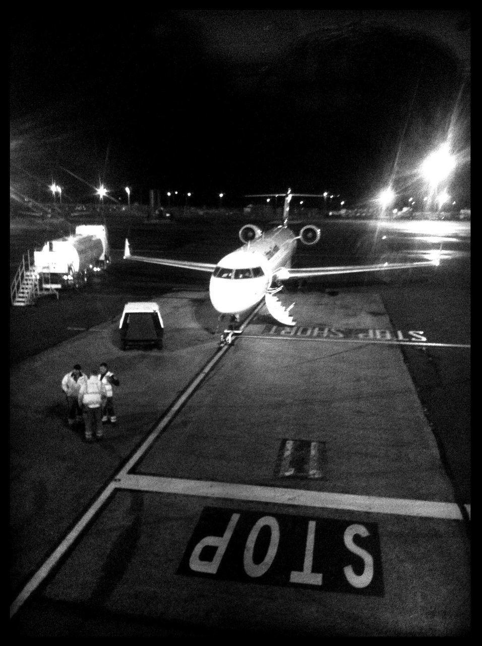 transportation, airport runway, mode of transport, night, illuminated, airport, airplane, car, air vehicle, land vehicle, outdoors, no people, runway