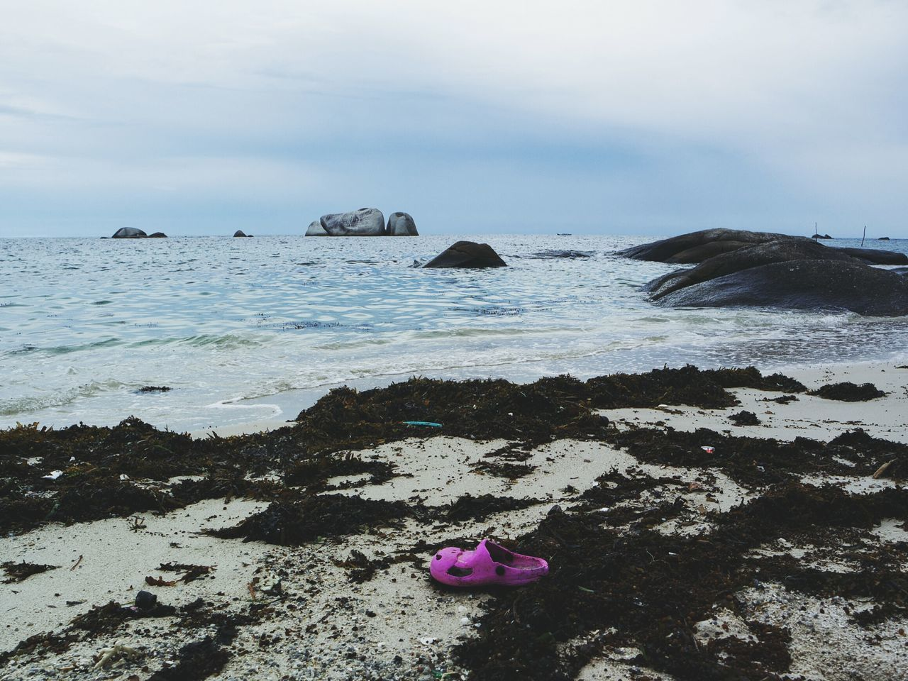 pink shoe Sea Water Tranquil Scene Scenics Tranquility Vacations Horizon Over Water Tourism Beauty In Nature Rock - Object Sky Travel Destinations Nature Seascape Majestic Outdoors Day Rock Formation Non-urban Scene Wave