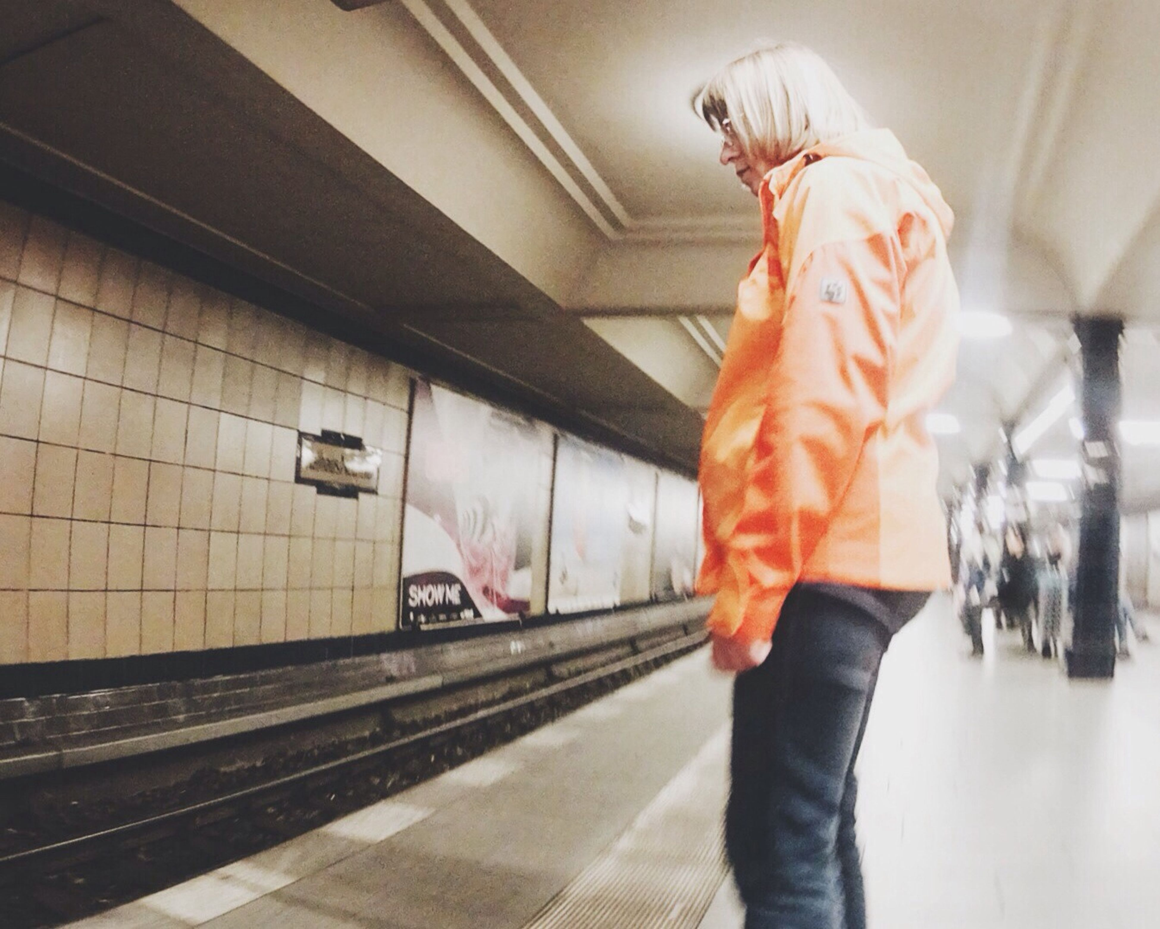indoors, lifestyles, men, person, leisure activity, standing, walking, architecture, low section, blurred motion, built structure, casual clothing, rear view, full length, incidental people, transportation, unrecognizable person, wall - building feature