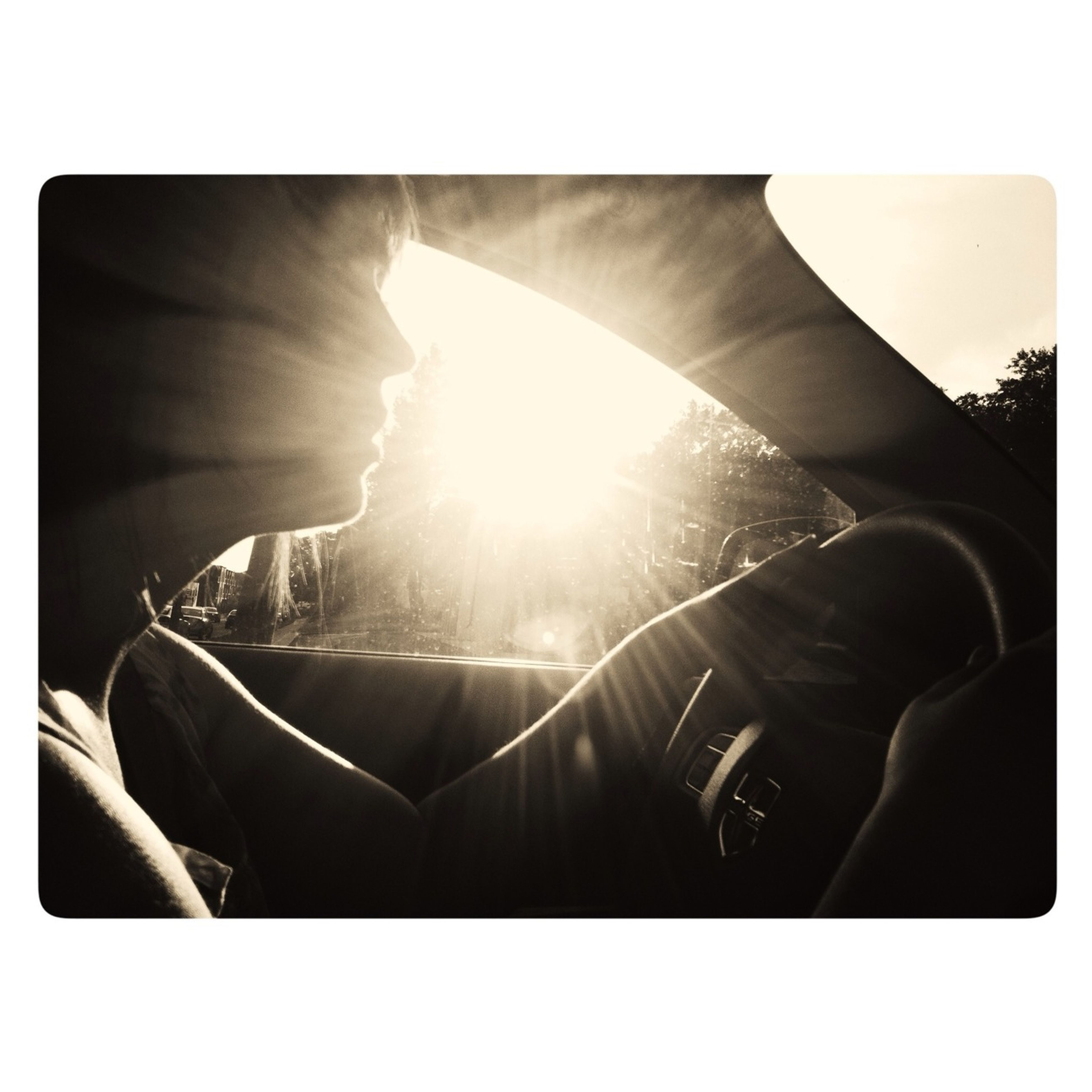 transfer print, sun, auto post production filter, sunbeam, sunlight, lens flare, lifestyles, leisure activity, men, sitting, person, silhouette, day, relaxation, part of, sky, bright