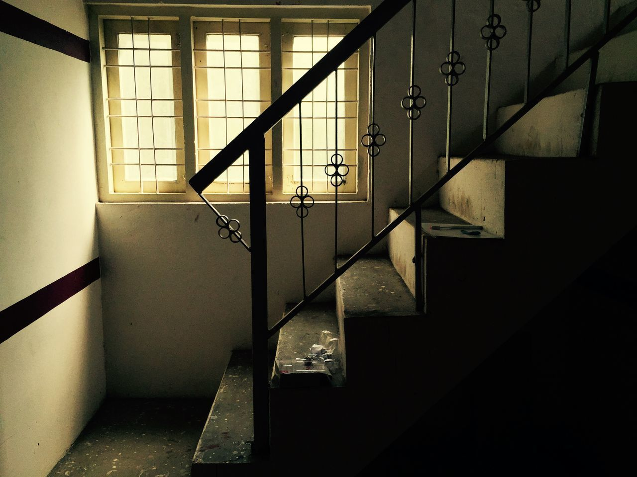 indoors, architecture, built structure, wall - building feature, window, railing, building, house, wall, no people, sunlight, home interior, staircase, building exterior, ceiling, metal, day, steps, shadow, steps and staircases