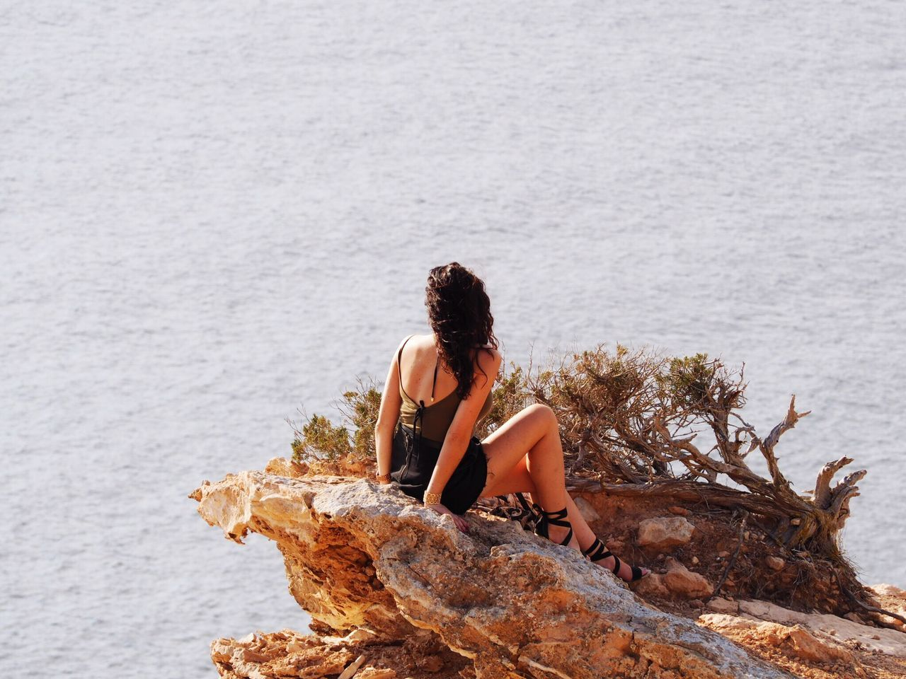 sitting, rock - object, sea, leisure activity, nature, water, day, two people, young adult, togetherness, outdoors, young women, full length, real people, beauty in nature, adult, people, adults only