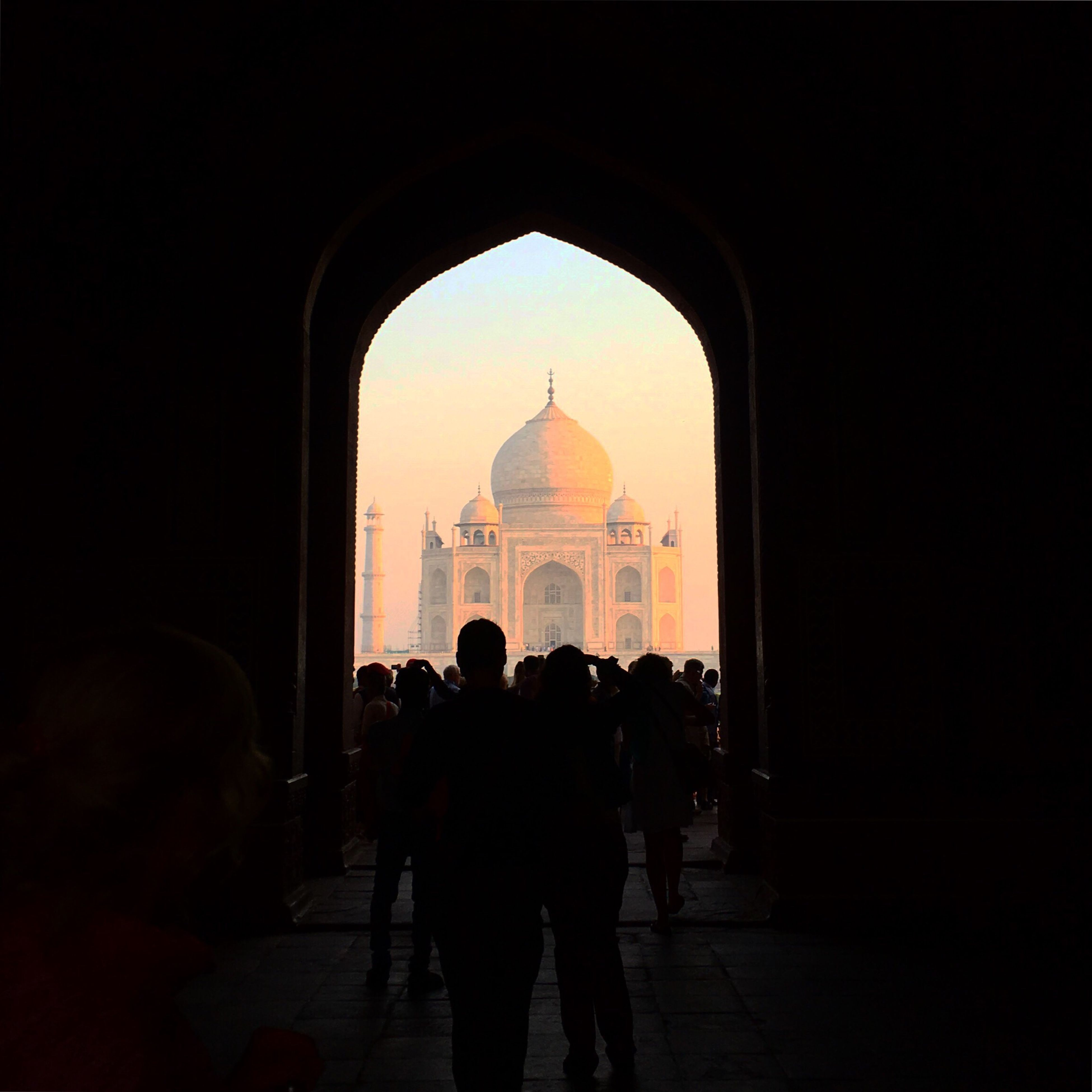arch, real people, architecture, silhouette, travel destinations, leisure activity, lifestyles, archway, built structure, tourism, cultures, dome, indoors, history, large group of people, men, day
