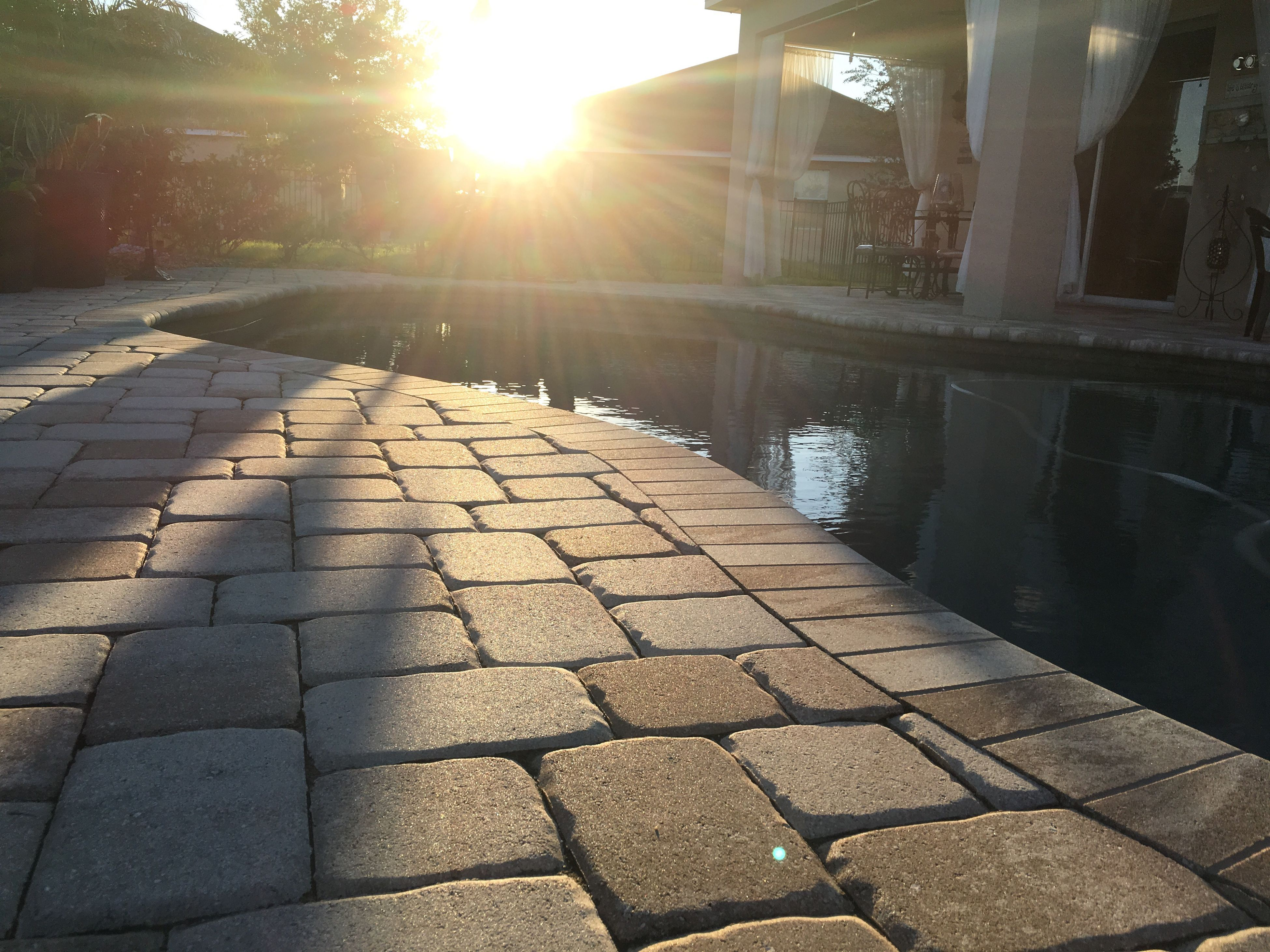 sun, sunlight, sunbeam, cobblestone, lens flare, sunny, paving stone, shadow, built structure, the way forward, footpath, architecture, outdoors, walkway, no people, bright, day, building exterior, railing, pattern