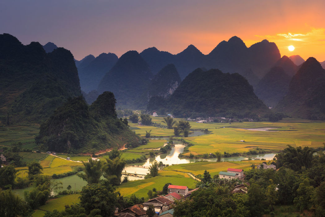Magical sunset on the area near mountain Phong Nam, Cao Bang province, Vietnam Agriculture Background Clouds Country Ecology Forest Farm Fog Foggy Morning Forest Horticulture Houses Magic Magical Minority Mountain No People Organic Outdoors Reflection River Rural Scene Tourism Traditional Valley Village