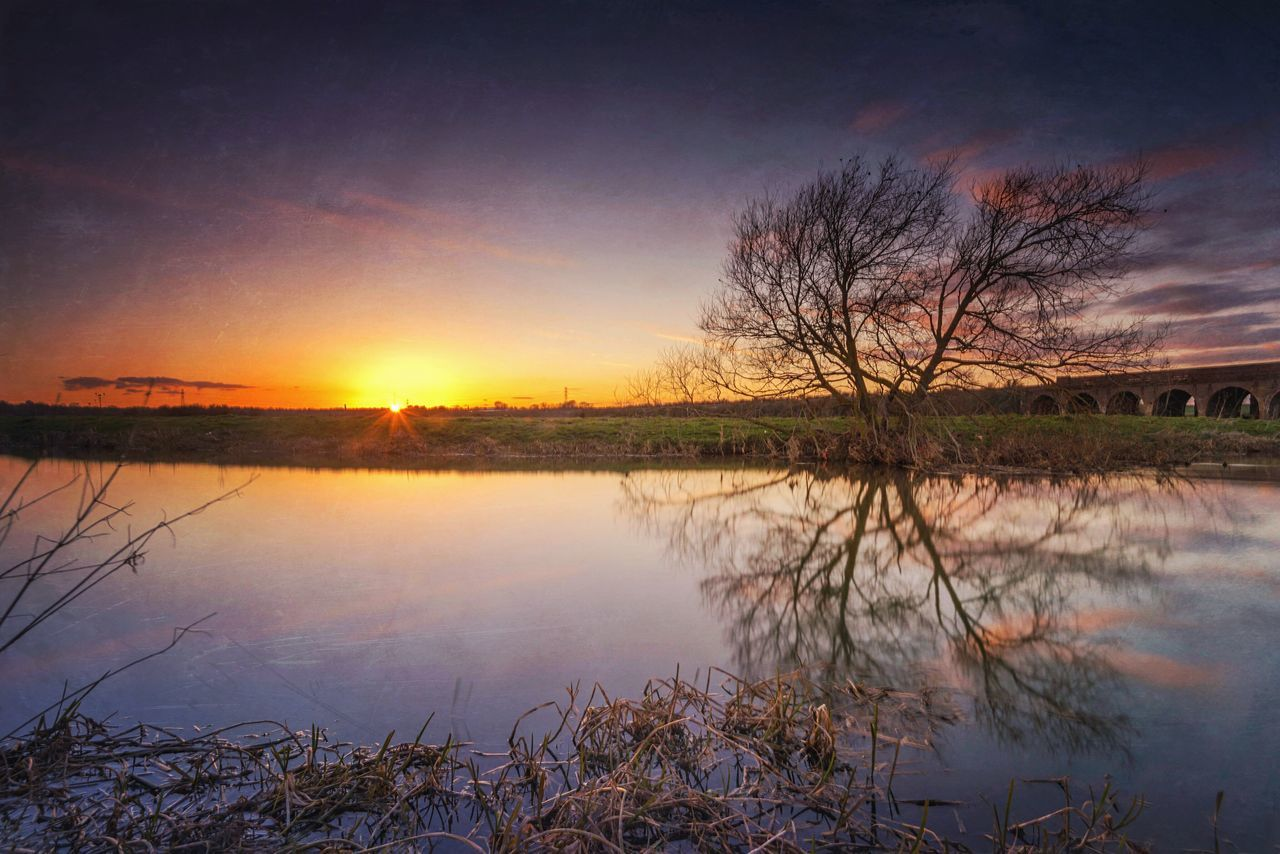 Warm Glow Sunset Tree Reflection  Riverscape River View Tree And Sky Tree And Sun Tree And Water Tree And River Sunset Reflections Northamptonshire River Nene Mextures Warm Colors Dusk Colours Sky And Clouds Long Exposure Things I Like Showcase April This Belongs To Me My Town Warmth Of The Sun The Great Outdoors With Adobe The Great Outdoors - 2016 EyeEm Awards The Essence Of Summer Nature's Diversities