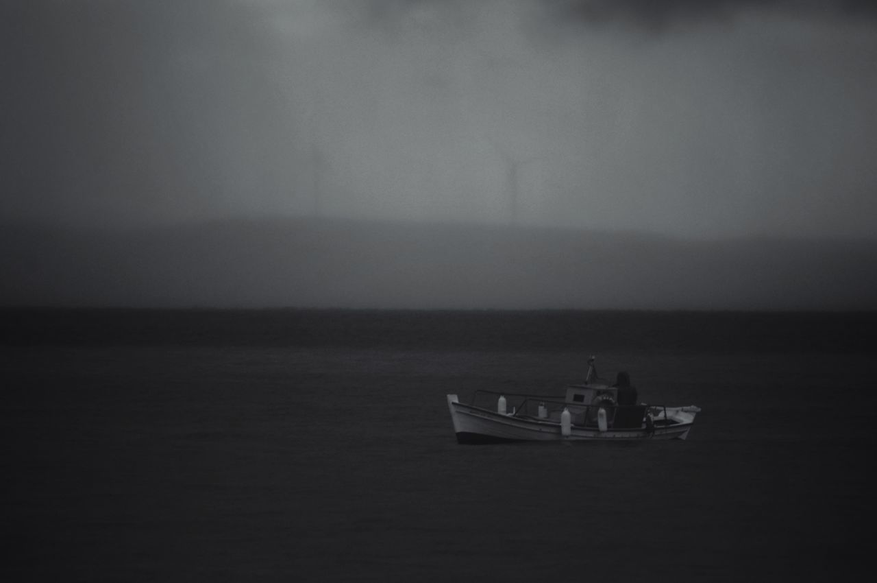 Blackandwhite Photography Fisherman Islandlife Fishing Boat Horizon Over Water Nautical Vessel Tranquility Beauty In Nature Darkness Getting Inspired Moody Weather Fishermen's Life Seascape Calm Sea Borderline Fishing Blackandwhite Dark Photography Tranquil Scene Depth Of Field - Aegean Sea Greek Islands Greece