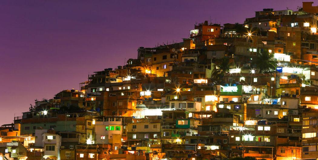 When the sun sets over the Favela in Rio de Janeiro Brazil. Brasil ♥ Brasilien Brazil Himmel Houses Rio Rio De Janeiro Brasil Brazilian Gallery Built Structure City Cityscape Favela Favelabrazil Favelas House Lights In The Dark Night No People Outdoors Sky Streetphotography Sunset