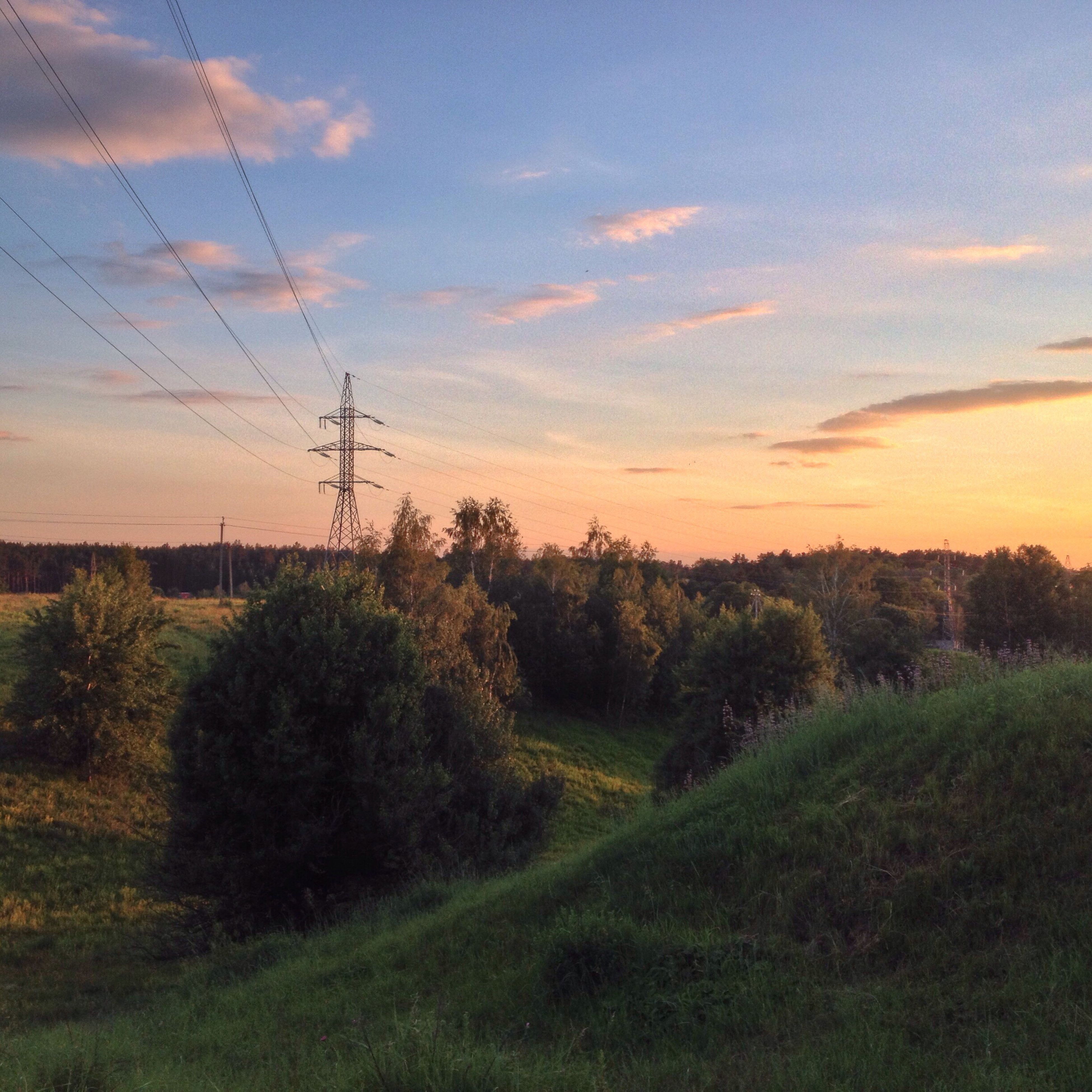 sky, electricity pylon, sunset, power line, landscape, tranquility, tranquil scene, field, tree, electricity, scenics, beauty in nature, nature, cloud - sky, growth, power supply, grass, connection, plant, cable