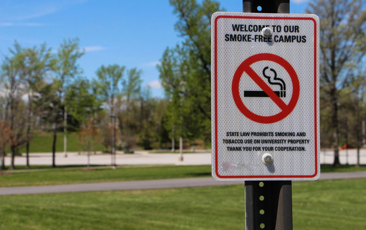 Communication Day Focus On Foreground Forbidden Grass Guidance Information Information Sign Landscape No People No Smoke No Smoking Outdoors Pole Red Road Sign Sign Sign Board Signboard Sky Smoke Text Tree Warning Sign Western Script