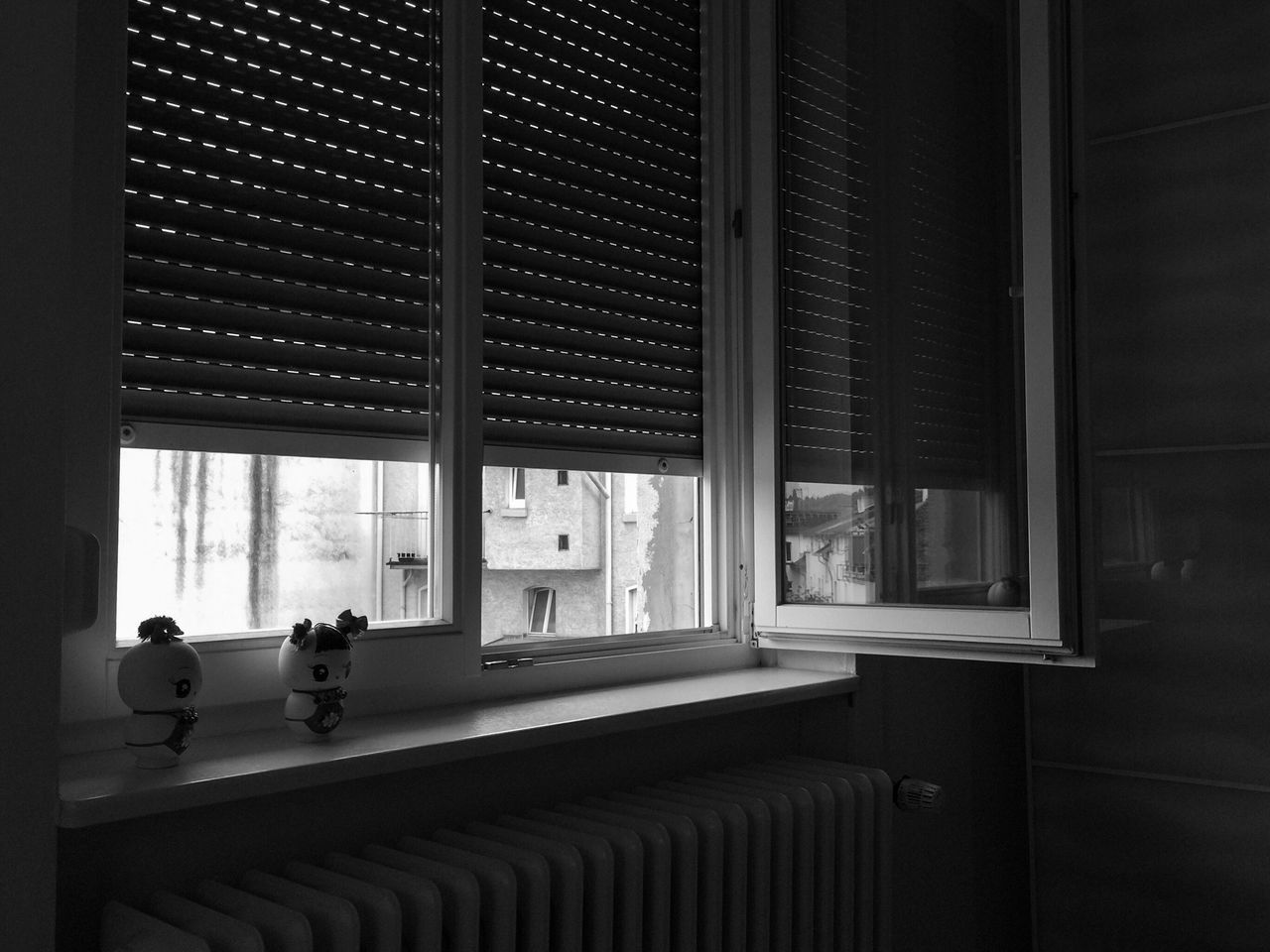 Dolls On Window Sill At Home