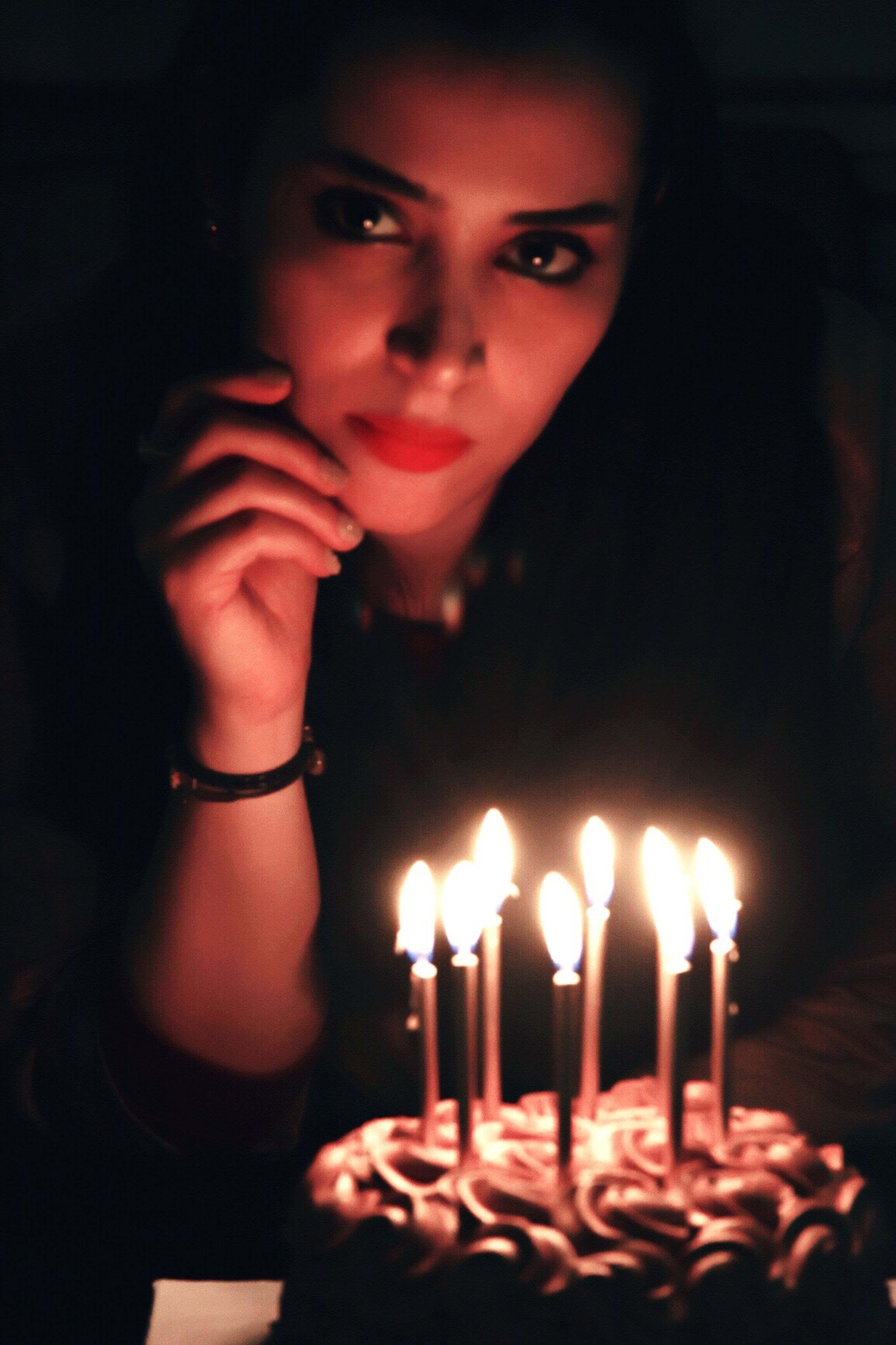 candle, flame, burning, one person, real people, indoors, front view, table, birthday cake, birthday candles, illuminated, celebration, igniting, women, beautiful woman, young women, close-up, young adult, people, adult, day