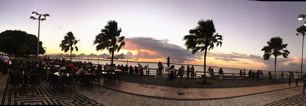 Estação das docas ♥️ Tree Large Group Of People Sunset Palm Tree Beach Nature Outdoors Beauty In Nature Tranquility Real People Sky Men Water People Day Adult Adults Only