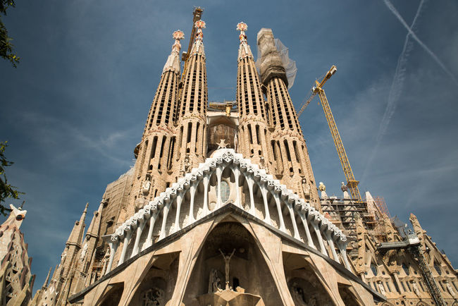 Sagrada Familia in Barcelona Arch Architectural Feature Architecture Blue Building Exterior Built Structure Cathedral Church City Duomo Di Milano Façade Famous Place Gothic Style History Low Angle View Milan Cathedral Outdoors Place Of Worship Religion Sagrada Familia Sagradafamilia Sky Spirituality Tourism Travel Destinations