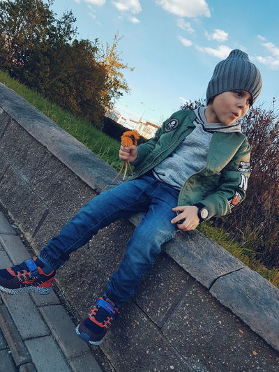 Childhood Child Children Only One Person Boys Full Length Casual Clothing People Day Outdoors Sky One Boy Only Males  Nature Adult Tree Low Angle View Headphones Beauty In Nature Water Branch Listening City Growth Sports Clothing