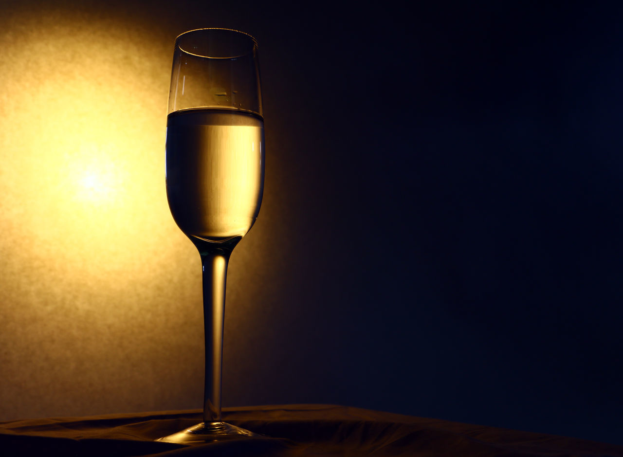 wineglass, alcohol, wine, table, drink, food and drink, still life, alcoholic drink, no people, drinking glass, refreshment, close-up, illuminated, indoors, freshness, night