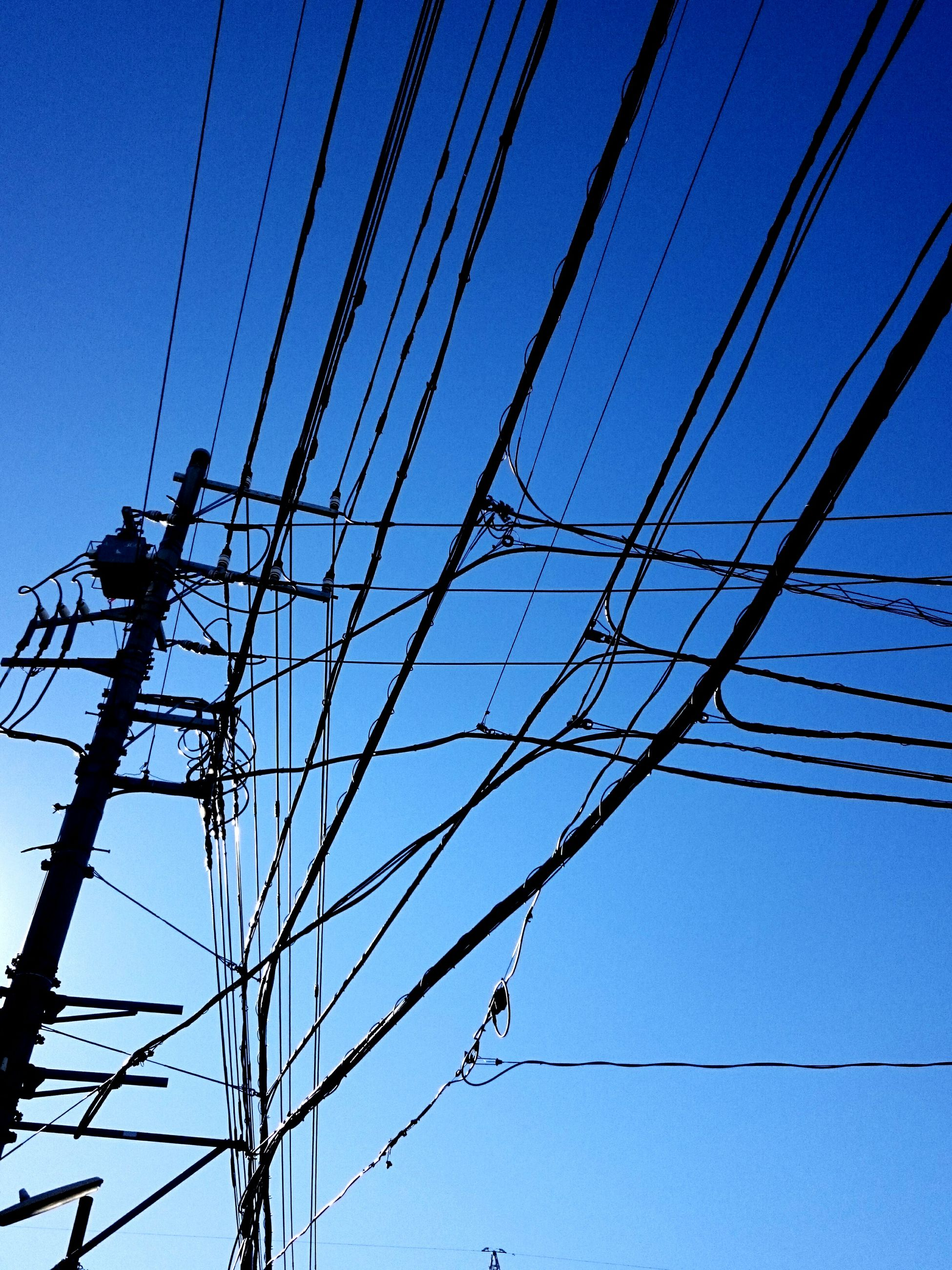 power line, connection, electricity pylon, low angle view, power supply, electricity, cable, blue, clear sky, fuel and power generation, technology, power cable, complexity, electricity tower, sky, outdoors, no people, day, steel cable, built structure