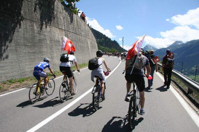 Cycling fans making their way up towards Verbier (Switzerland) for the final climb of Stage 15 in the 2009 Tour de France race. http://pics.travelnotes.org/ Cycling CyclingUnites Day Flags Healthy Lifestyle Medium Group Of People Michel Guntern Mixed Age Range Motion Mountain On The Move People And Places Outdoors Riding Road Sky Swiss Swiss Alps Tour De France Travel Travel Photography Travel Photos Travel Pics Verbier Let's Go. Together.