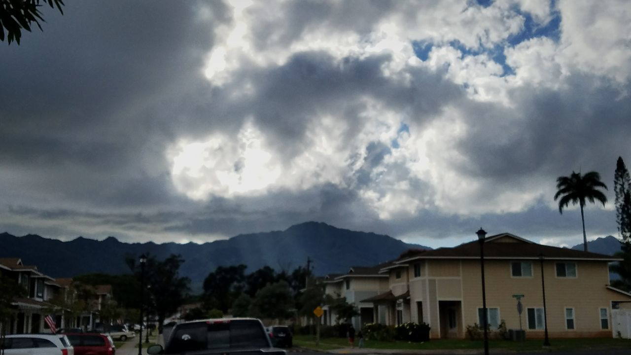 house, cloud - sky, sky, car, building exterior, architecture, built structure, no people, outdoors, town, tree, day, mountain, palm tree, storm cloud, nature, city, thunderstorm
