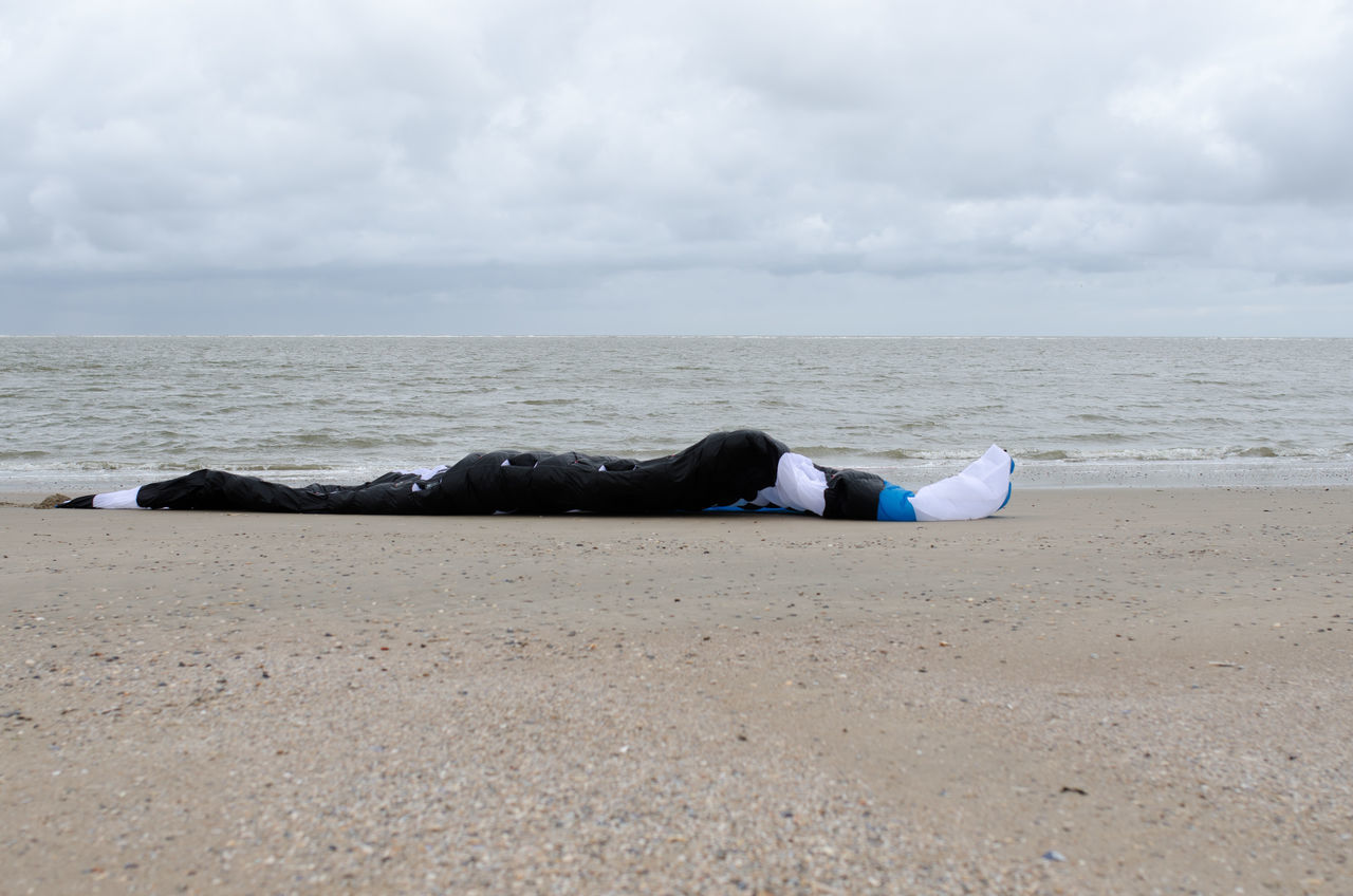 Beach Beauty In Nature Cloud - Sky Day Hoffi99 Horizon Over Water Low Section Lying Down Nature North Sea Coast North Sea Region One Person Outdoors People Real People Sand Sea Sky Strong Wind Water