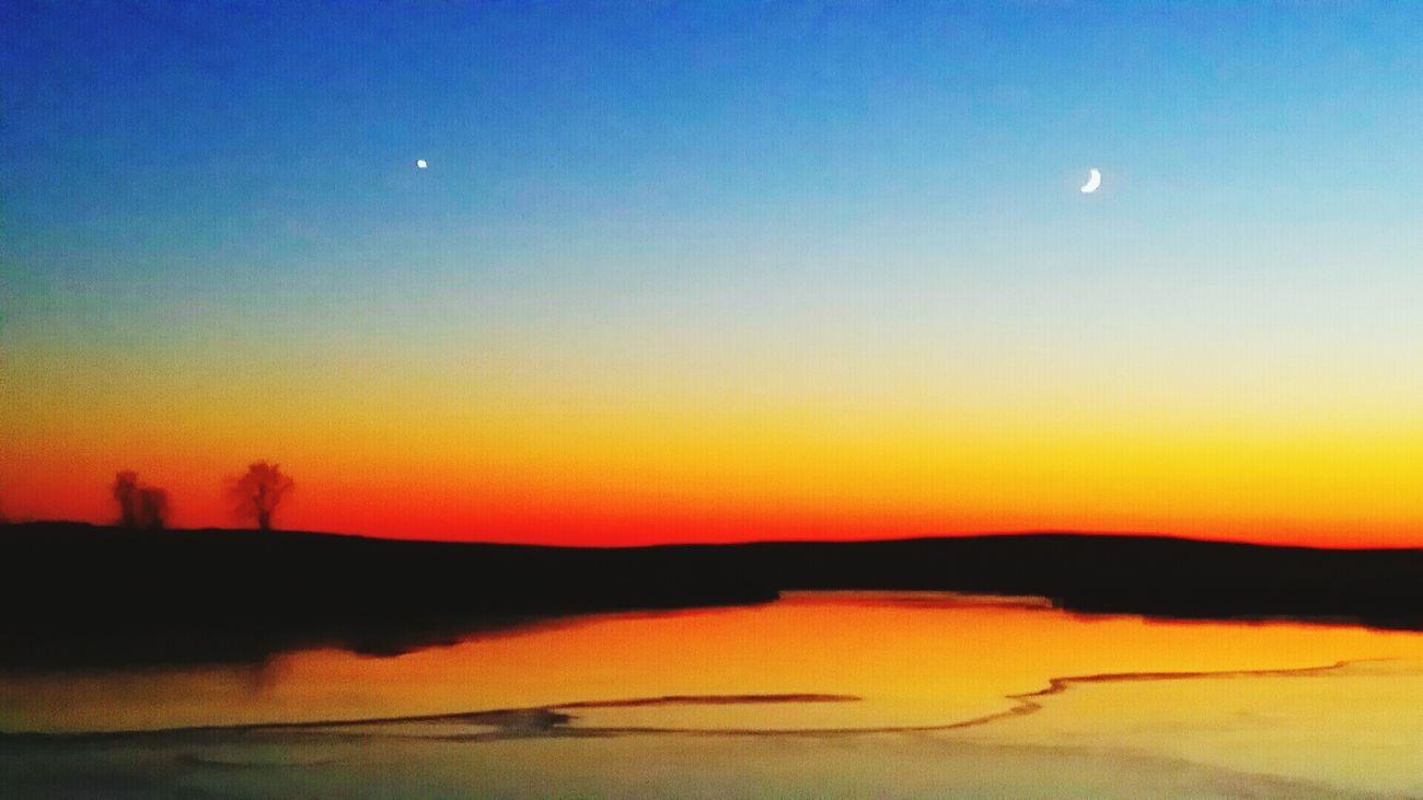 Sunset over a frozen Minnesota pond. Minnesota Sunset_collection Sunrise Sunset Silouette & Sky Moon And Stars Sunsetporn Sunset And Moon Sunset Silhouettes Minnesota Nature Sunsetlover Minnesotalife Minnesota Lake