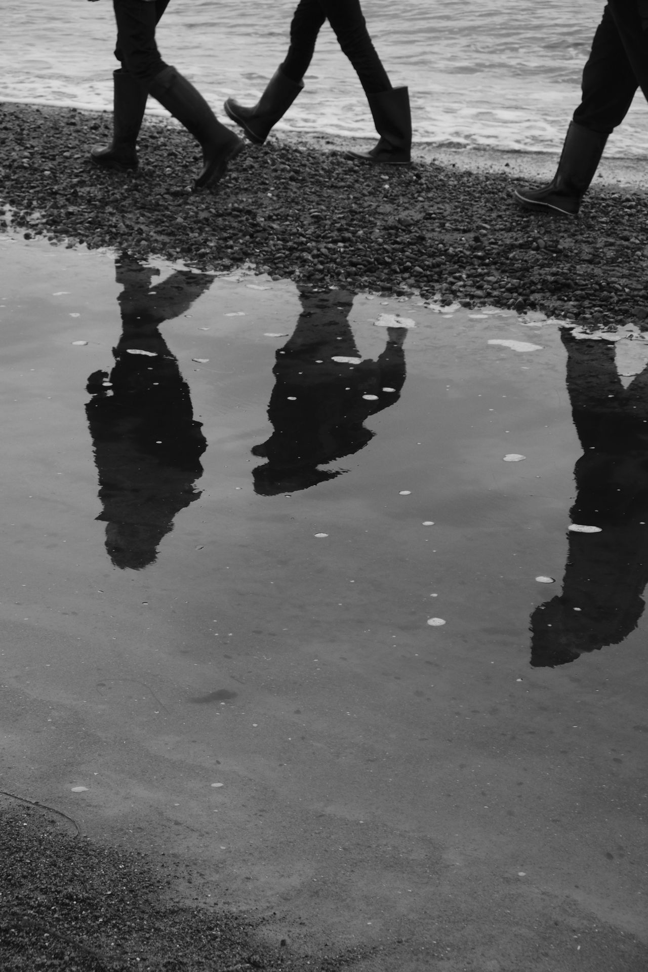 Baltic Sea Beach Black And White Blackandwhite Chillyweather  Human Body Part Human Leg Outdoors People Puddle Real People Reflection Rubber Boots Sea Street Photography Streetphotography Walking Water Wellington
