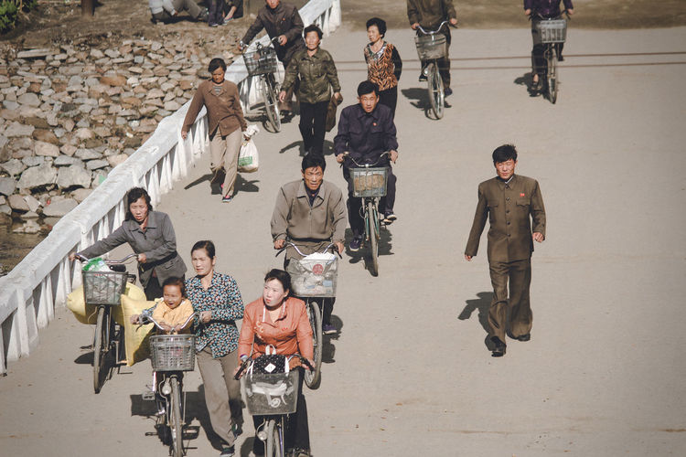 North Korea North Korea Photos High Angle View Large Group Of People Men Outdoors Real People Standing Street Transportation
