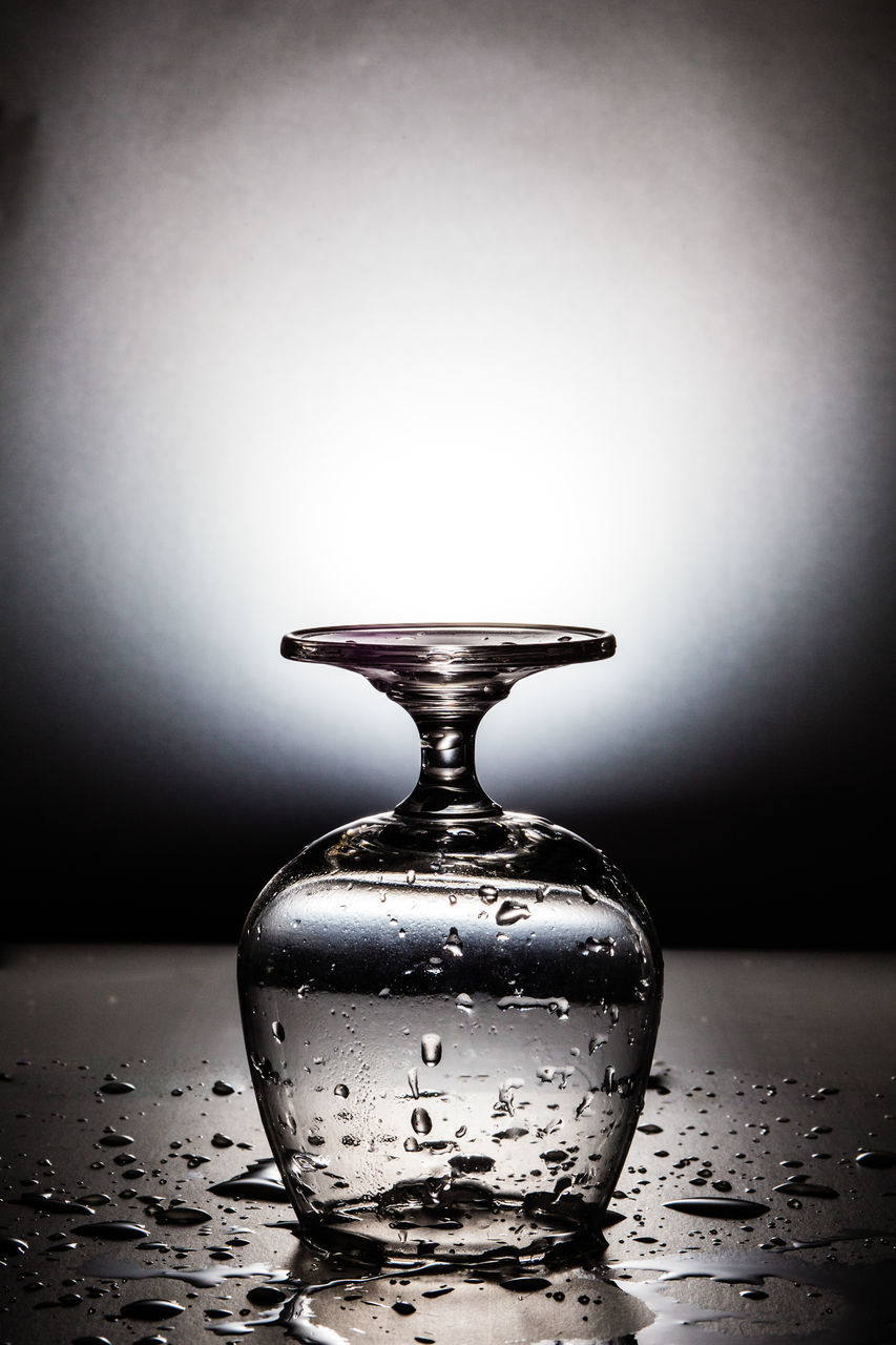 bottle, table, reflection, drop, indoors, no people, close-up, water, studio shot, perfume sprayer, freshness, day