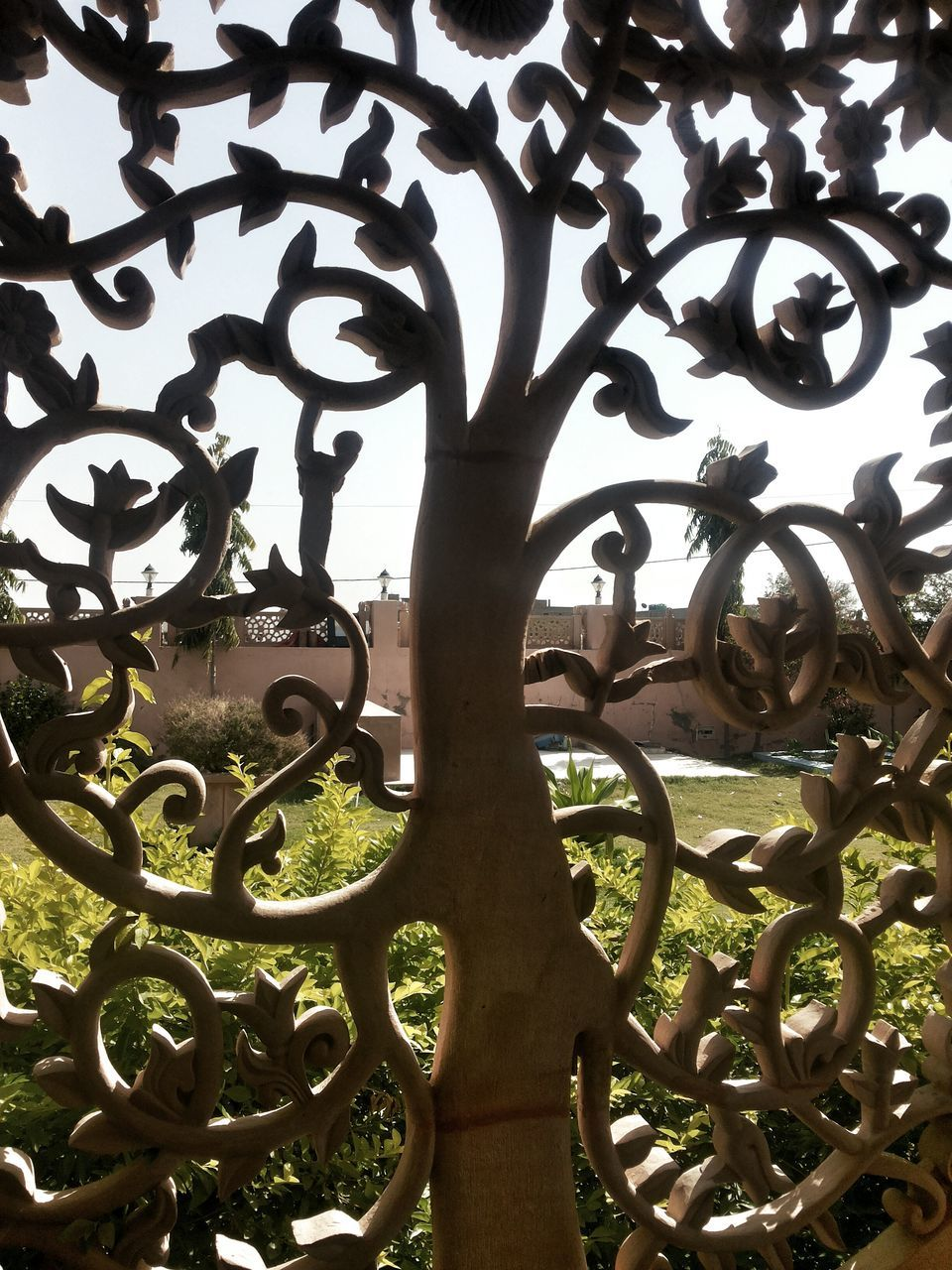 metal, wrought iron, day, outdoors, close-up, no people, tree, sky