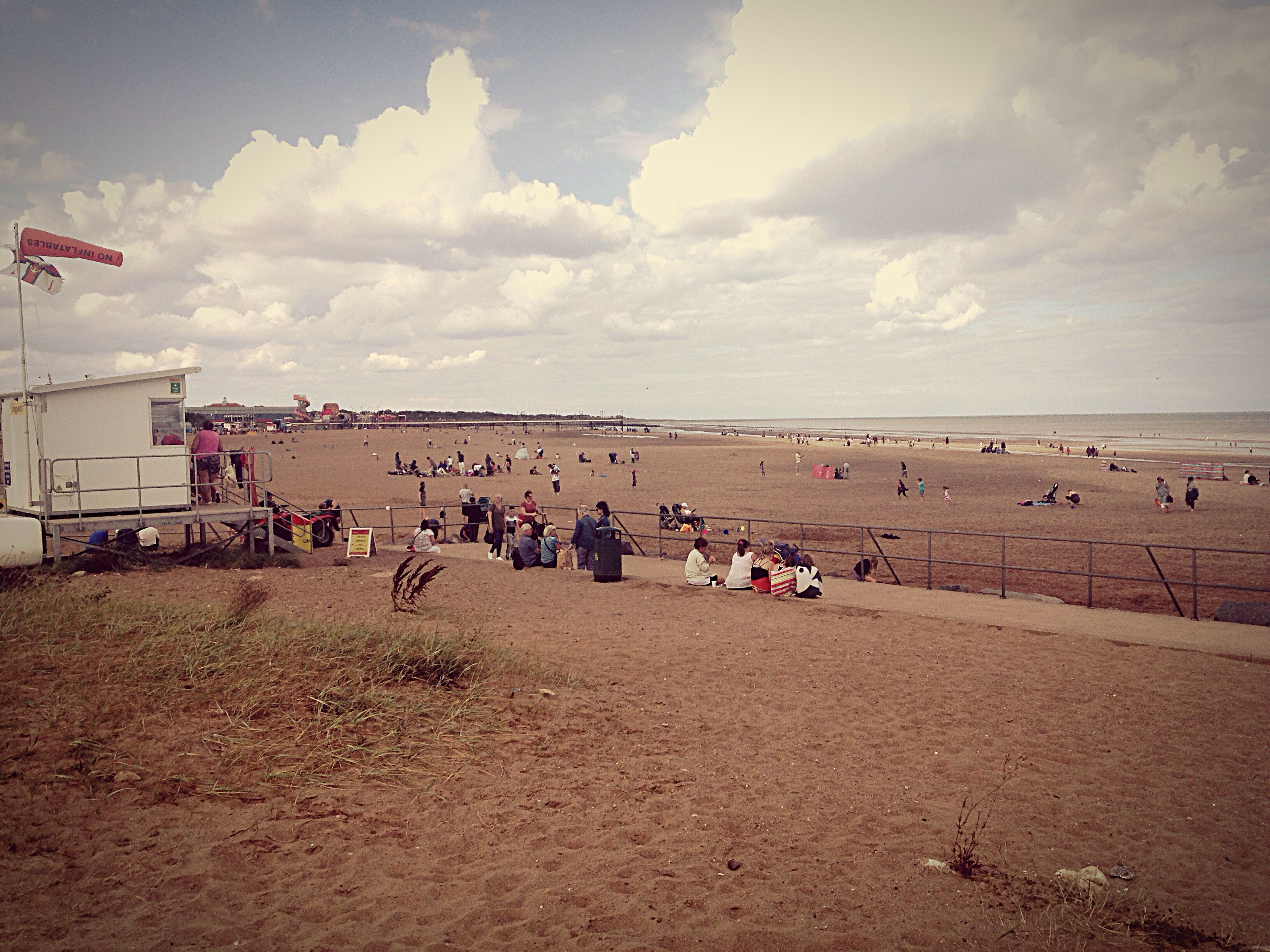 large group of people, horizon over water, sea, cloud - sky, water, leisure activity, vacations, beach, lifestyles, sky, tourist, tourism, person, day, tranquil scene, cloudy, scenics, nature, weekend activities, tranquility, outdoors, beauty in nature, beach holiday, journey, city life