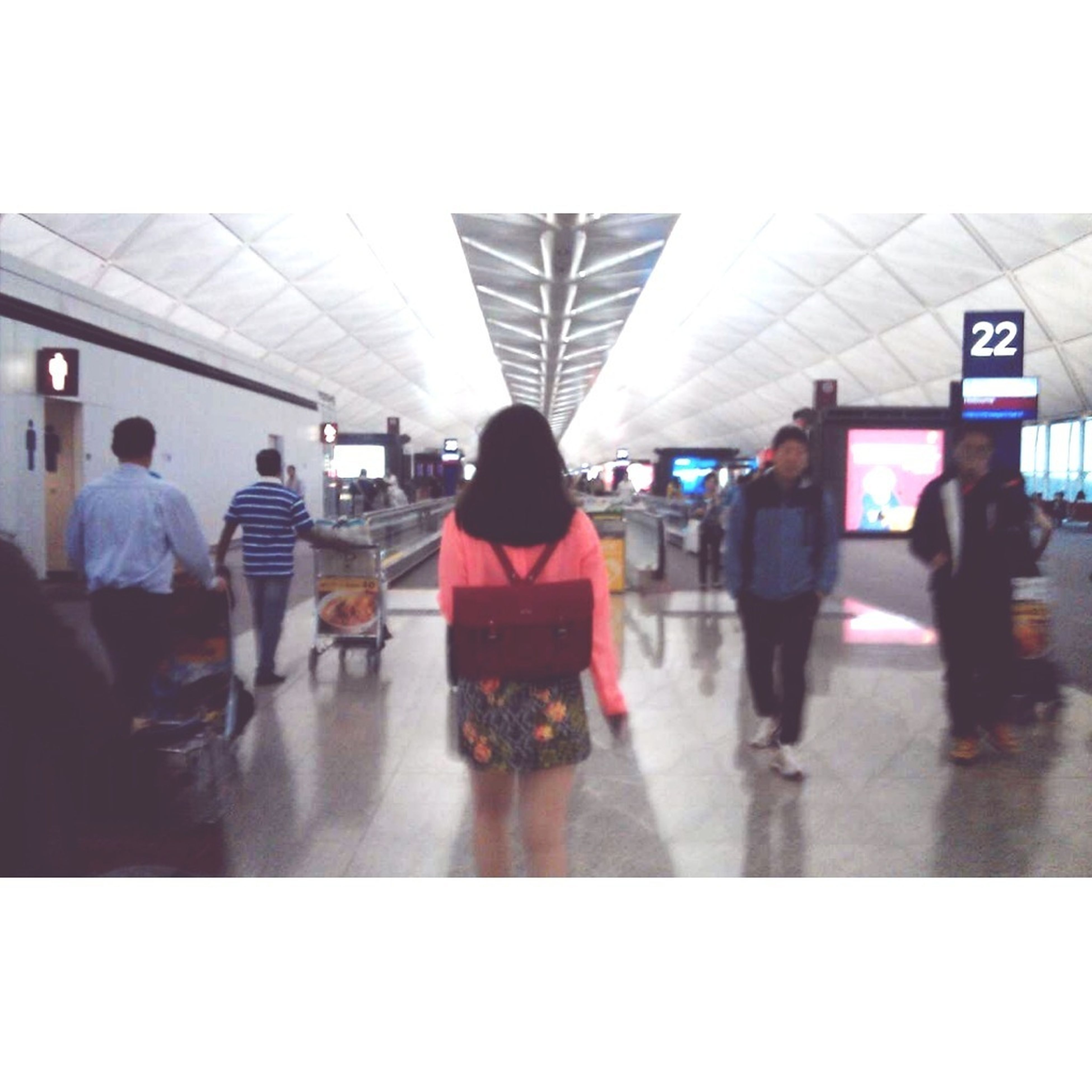 men, lifestyles, person, large group of people, walking, indoors, rear view, leisure activity, transportation, standing, public transportation, city life, medium group of people, full length, travel, passenger, casual clothing, railroad station, railroad station platform