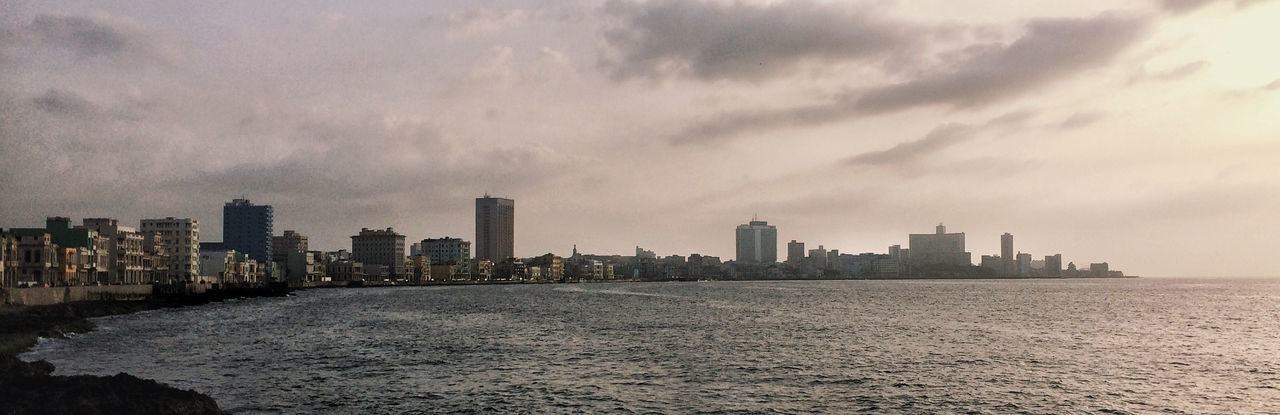 Malecon de La Habana Connected By Travel Architecture Building Exterior Built Structure City Cityscape Cloud - Sky Day Modern Nature No People Outdoors Sea Sky Skyscraper Sunset Travel Destinations Urban Skyline Waterfront