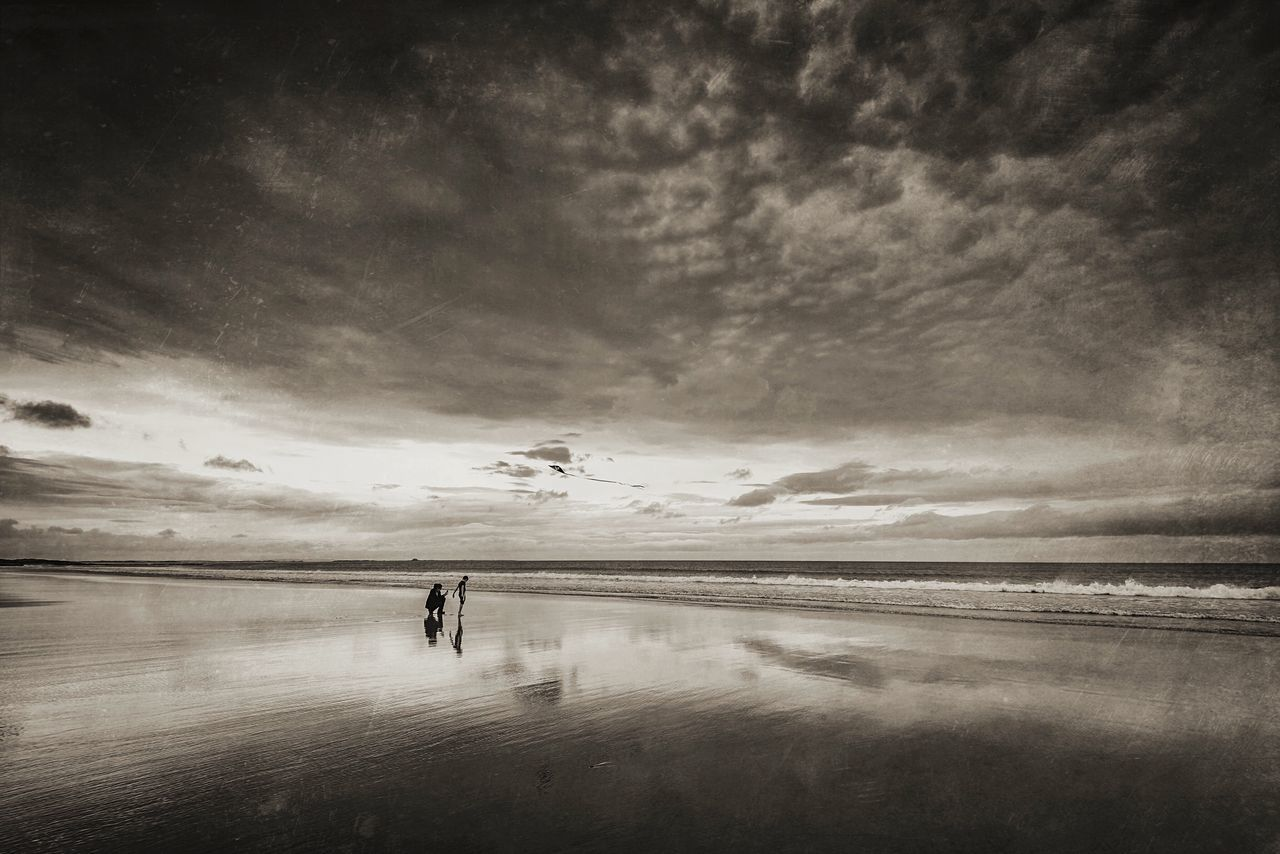 Beach Band Sea Cloud - Sky Sea And Sky Beach Scenics Beauty In Nature Outdoors Flying A Kite Beachphotography BW Collection BW Landscape Landscape Northumberland Bamburgh Skyporn Cloudporn Cloud_collection  People On The Beach Blackandwhite Monochrome Moody Moody Sky Adults Only Seaside