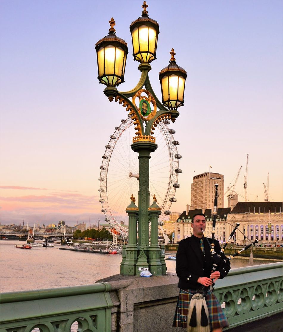 Travel Destinations Bridge - Man Made Structure Architecture Urban Skyline Sunset Sunset_collection Sunset_captures Bagpipes Bagpipers Westminster Bridge Westminsterbridge London Eye LondonEye London Lifestyle London_only Londonlife London London Streets Londonthroughmycam Londonstreets London Trip Londoncity Thames Thames River Thamesriver