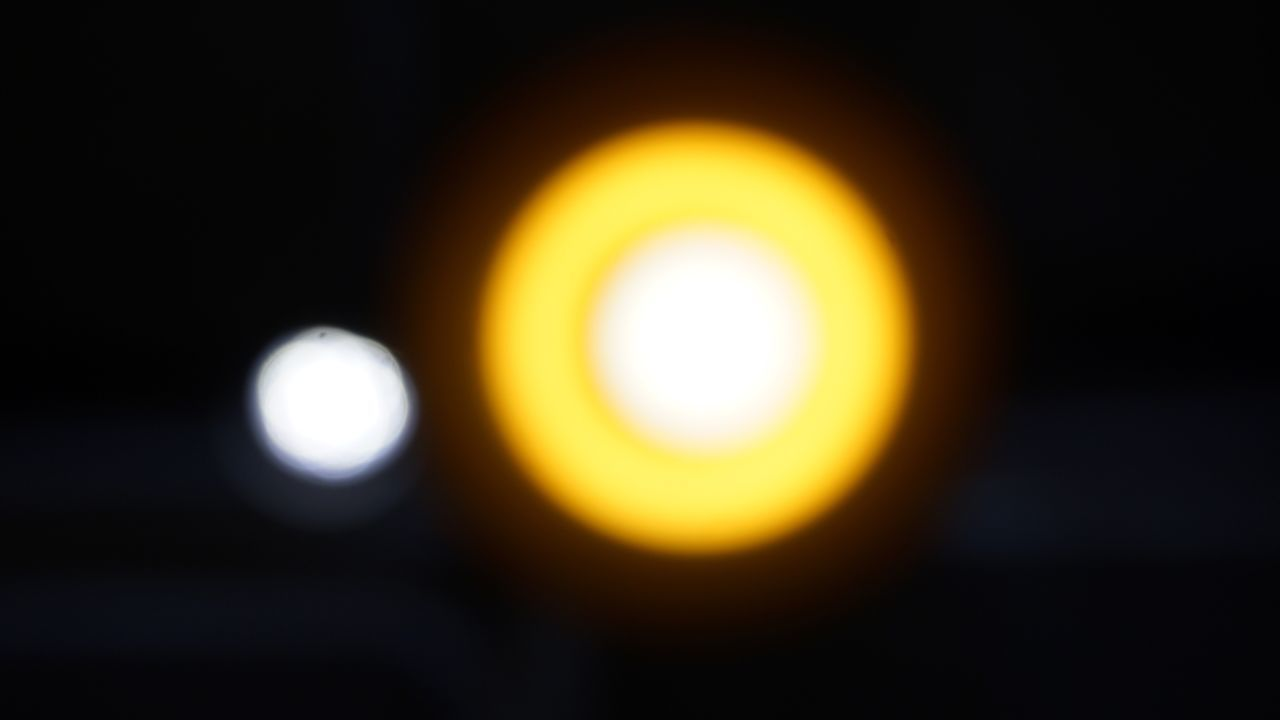 lens flare, glowing, sun, illuminated, no people, focus on foreground, yellow, outdoors, defocused, beauty in nature, nature, sky, close-up, astronomy