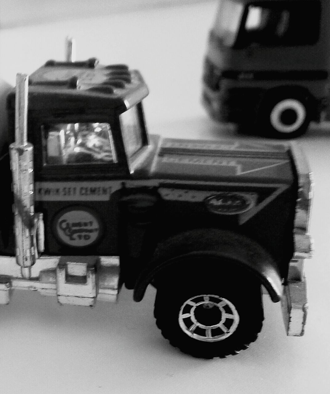 transportation, no people, land vehicle, close-up, toy car, outdoors, day, tire